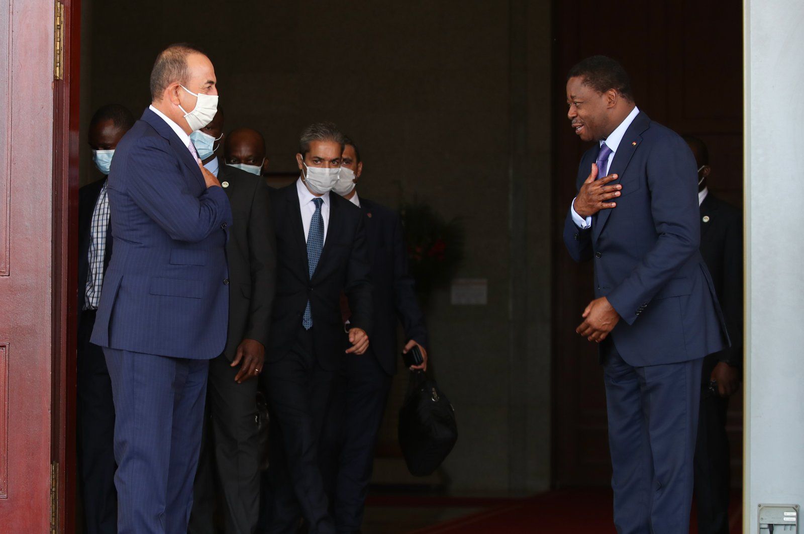 Turkish Foreign Minister Mevlüt Çavuşoğlu (L) is greeted by Togo's President Faure Gnassingbe (R) on an official visit to the capital Lome, Togo, July 20, 2020. (AA Photo)