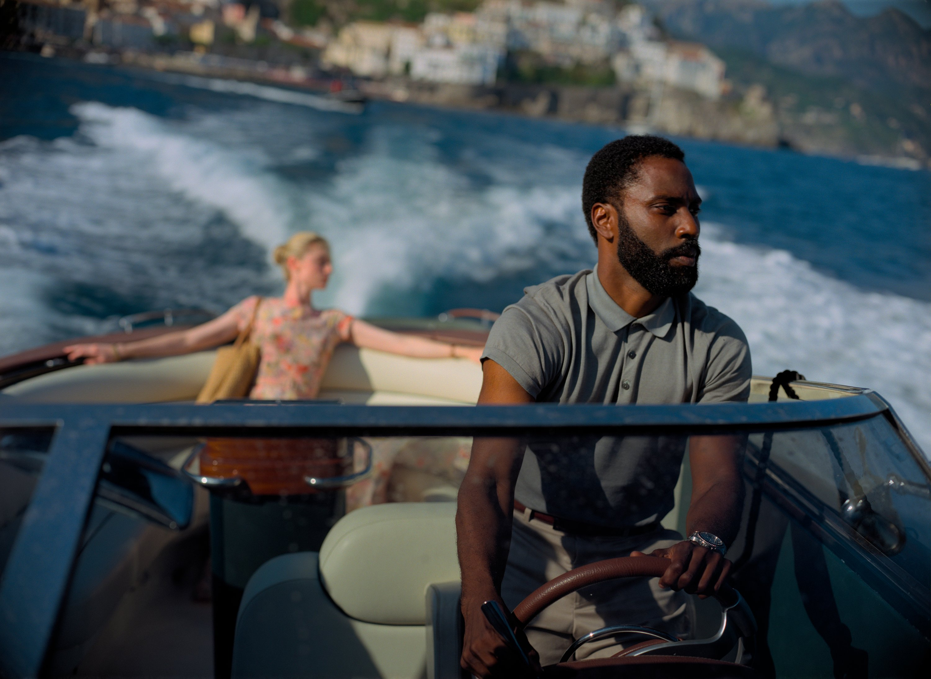 This image released by Warner Bros. Entertainment shows Elizabeth Debicki (L), and John David Washington in a scene from