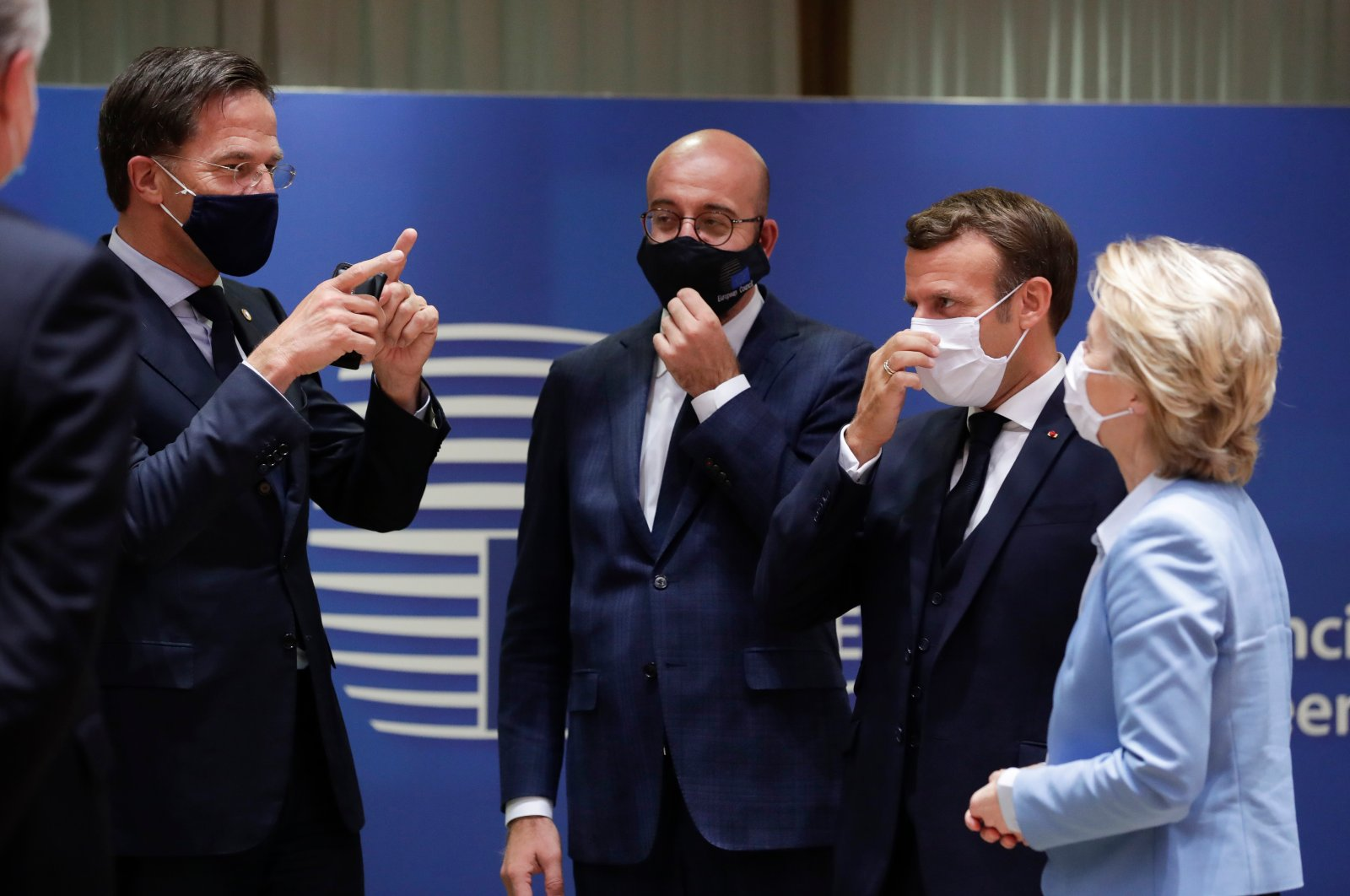 Dutch Prime Minister Mark Rutte (L), European Council President Charles Michel (2nd from L), French President Emmanuel Macron (2nd from R) and European Commission President Ursula von der Leyen (R) attend a round table meeting at an EU summit in Brussels, Belgium, July 21, 2020. (AP Photo)