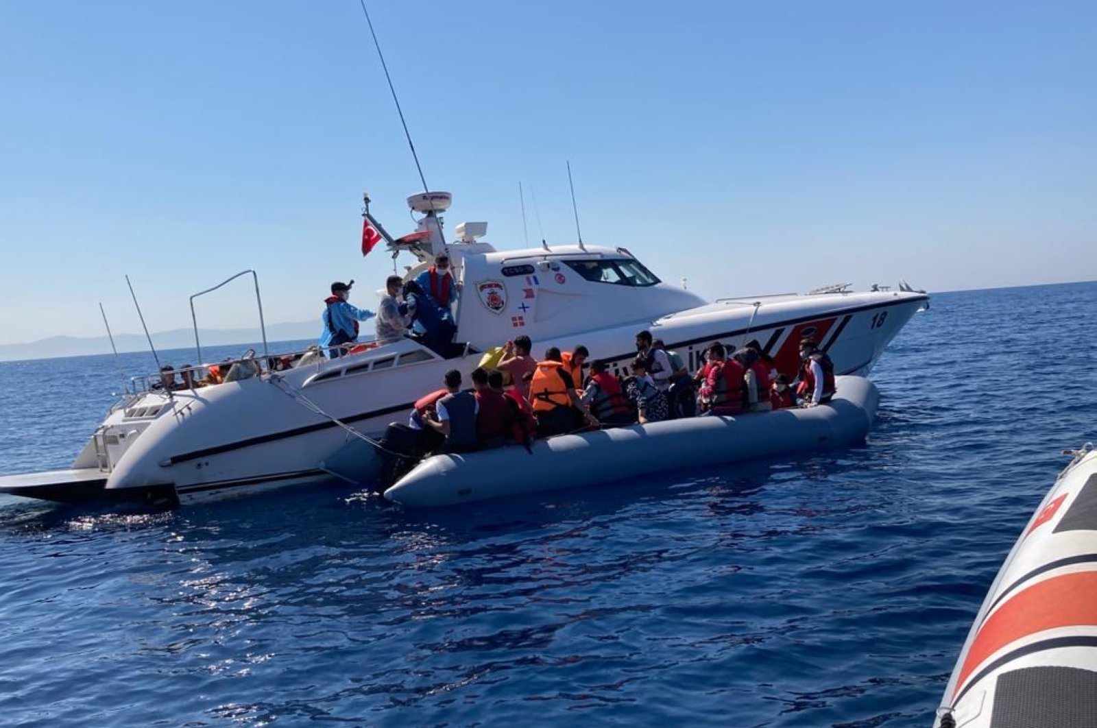 The Turkish coast guard saves the migrants in the Aegean Sea, July 21, 2020. (DHA Photo)