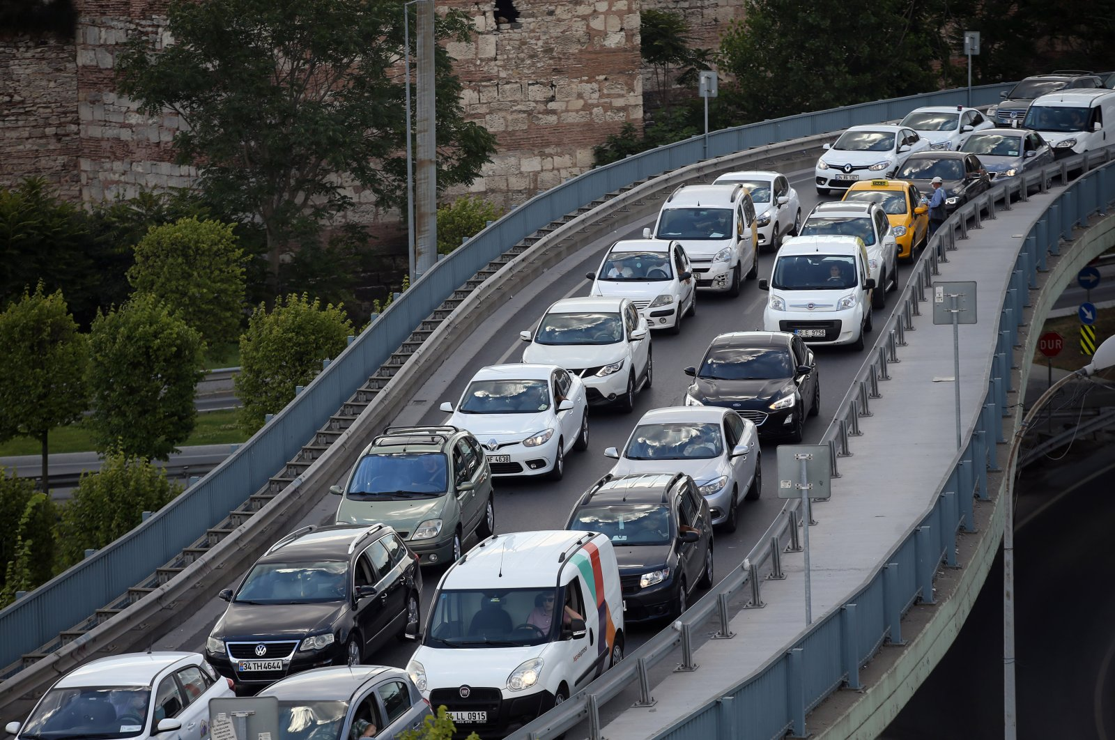 Cars drive on the D-100 state highway in the Edirnekapı neighborhood of Istanbul, July 21, 2020. (AA Photo)