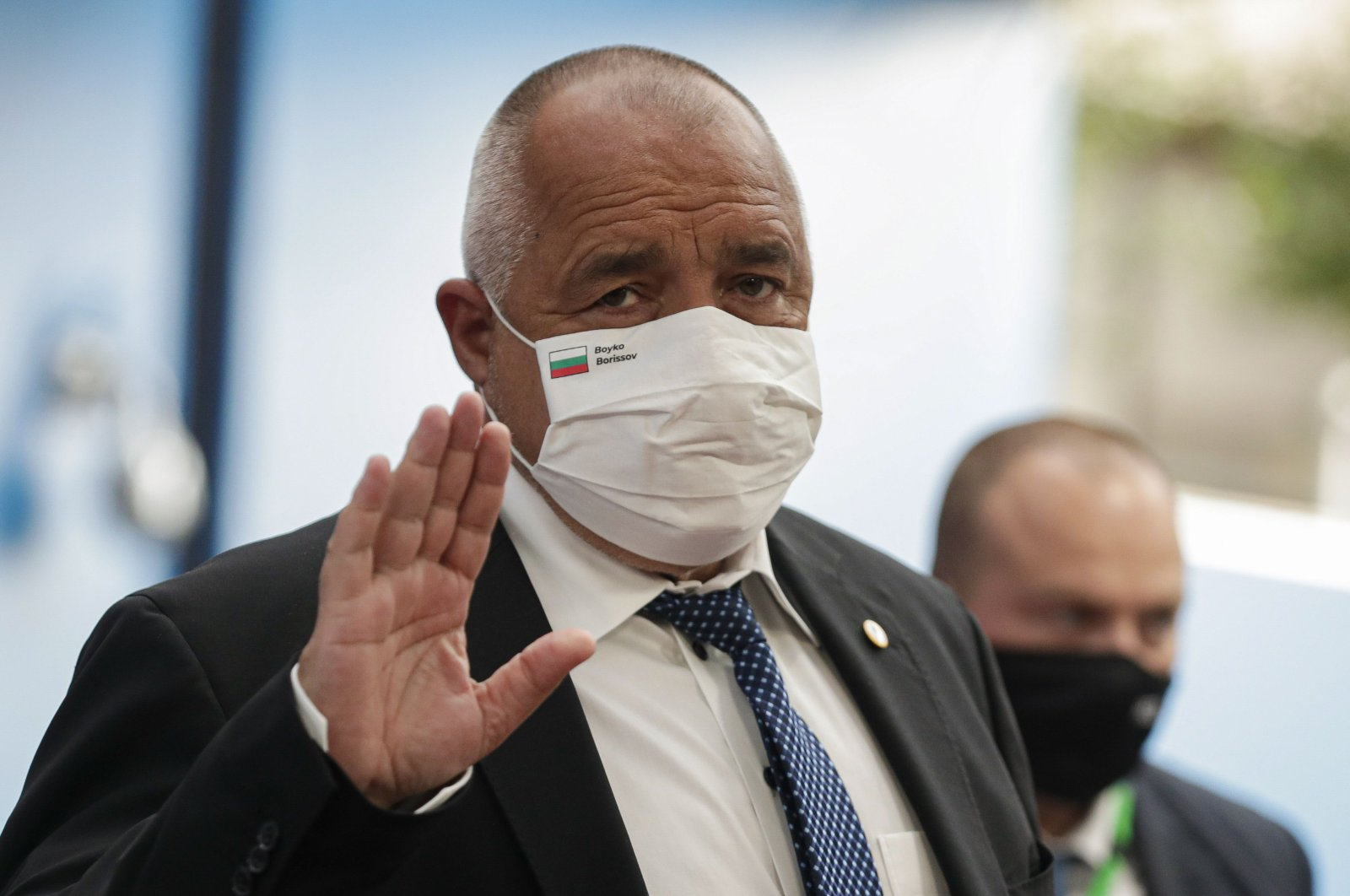 Bulgaria's Prime Minister Boyko Borissov, wearing a protective face mask, waves as he arrives for the fourth day of an EU summit at the European Council building in Brussels, on July 20, 2020. (AFP Photo)