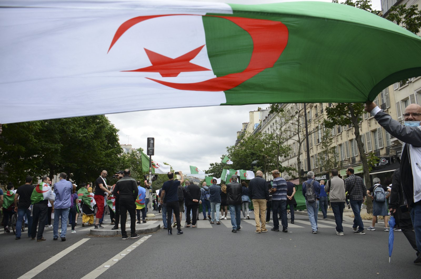 A parade by the Algerian population in Paris is held from Place de la Republique in the direction of the Bastille to commemorate Algeria's independence, in Paris, France, June 5, 2020. (Reuters Photo)