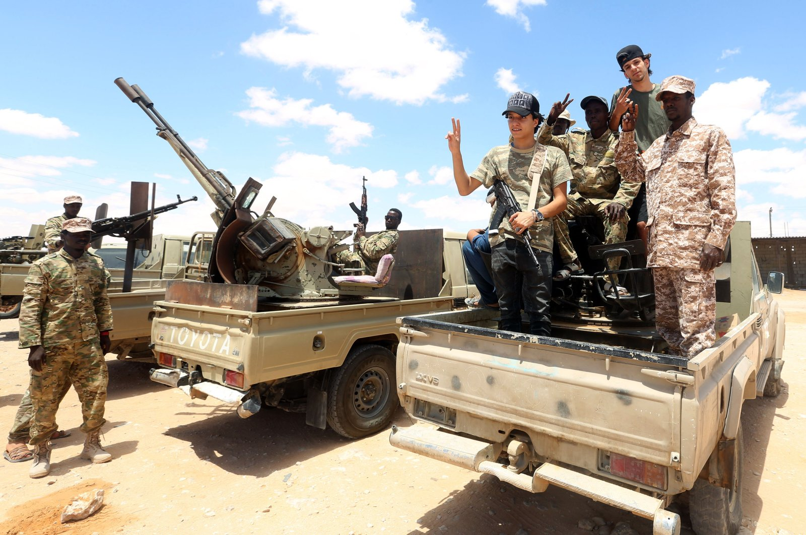 Fighters loyal to the UN-recognized Libyan Government of National Accord (GNA) secure the area of Abu Qurain, half-way between the capital Tripoli and Libya's second city Benghazi, against forces loyal to Khalifa Haftar, who is based in eastern Benghazi, July 20, 2020. (AFP Photo)