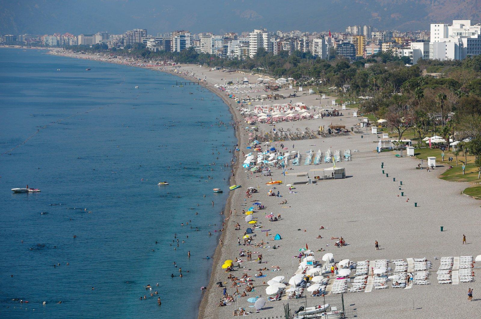 People enjoy the sunny weather at the Konyaaltı Beach in Antalya, southern Turkey, Sept. 10, 2019. (DHA Photo)