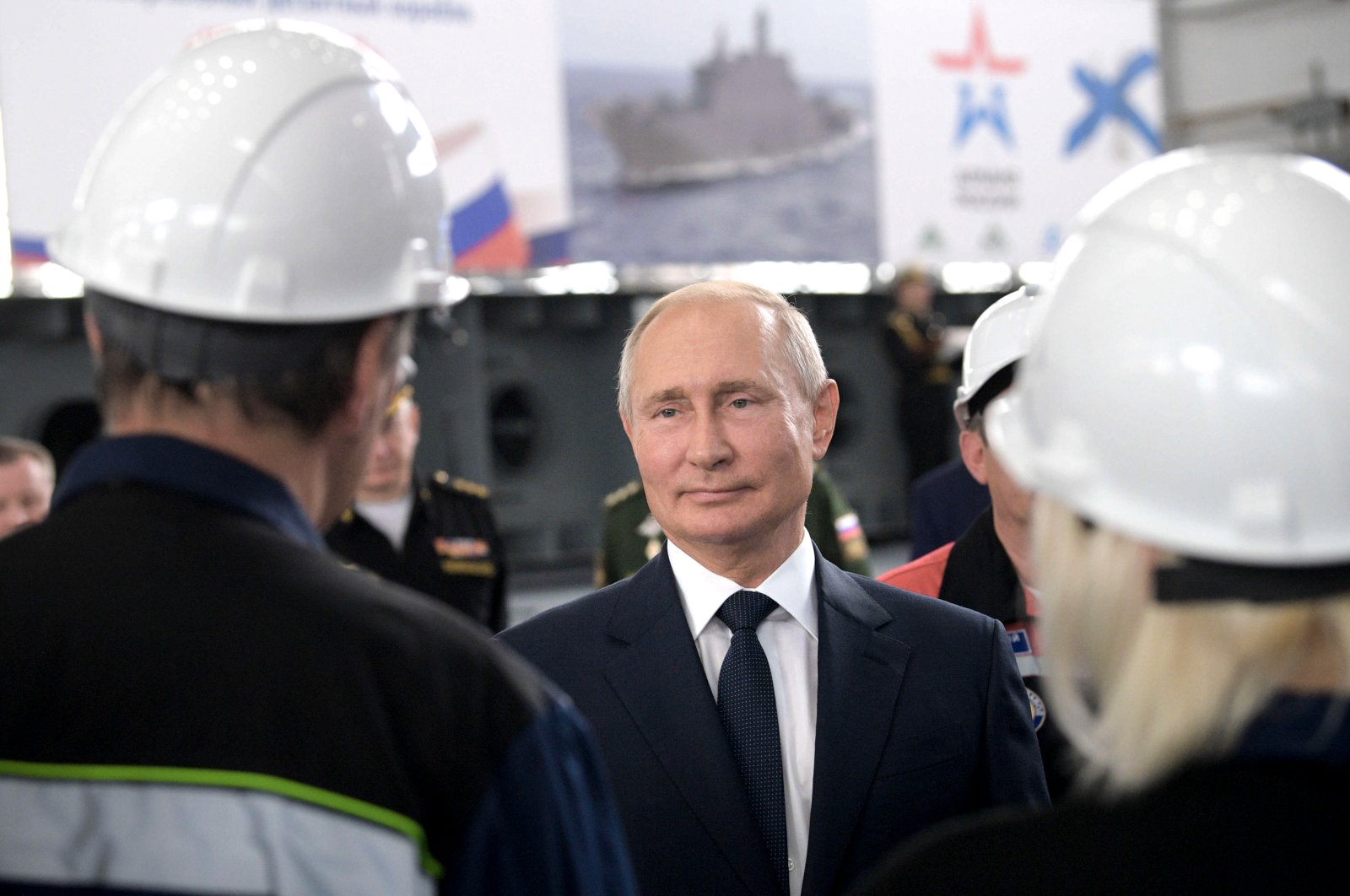 Russian President Vladimir Putin meets with workers at the Zaliv shipyard in Kerch, Crimea, Monday, July 20, 2020. (AP Photo)