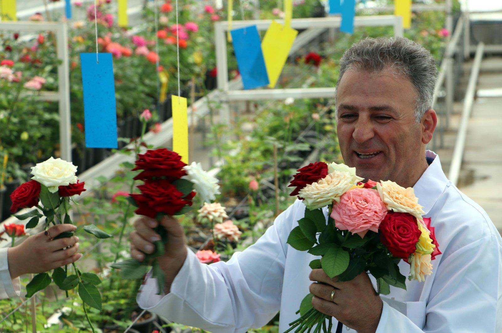 Soner Kazaz poses with roses, in the capital Ankara, Turkey, July 21, 2020. (DHA Photo)