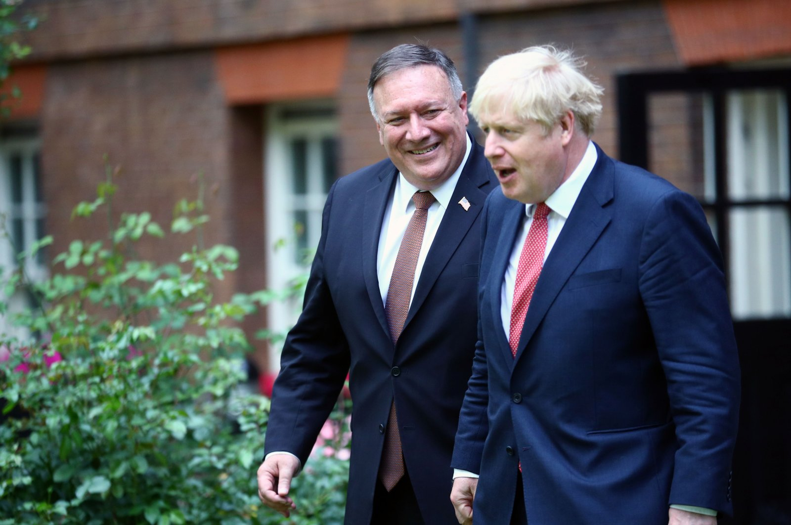 U.S. Secretary of State Mike Pompeo (L) talks with Britain's Prime Minister Boris Johnson on arrival at Downing Street in central London, Britain, July 21, 2020. (AFP Photo)