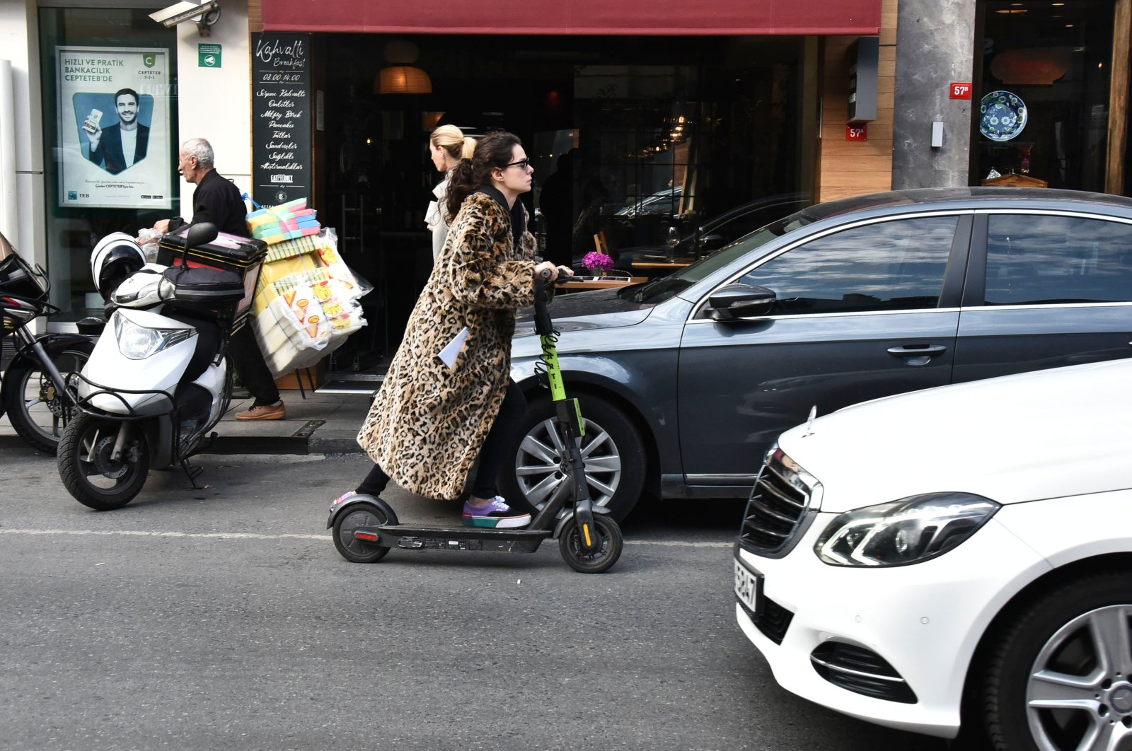 Actress Özge Özpirinççi rides an e-scooter in Bebek neighborhood, in Istanbul, Turkey, December 2, 2019. (PHOTO BY ALİ KESER)