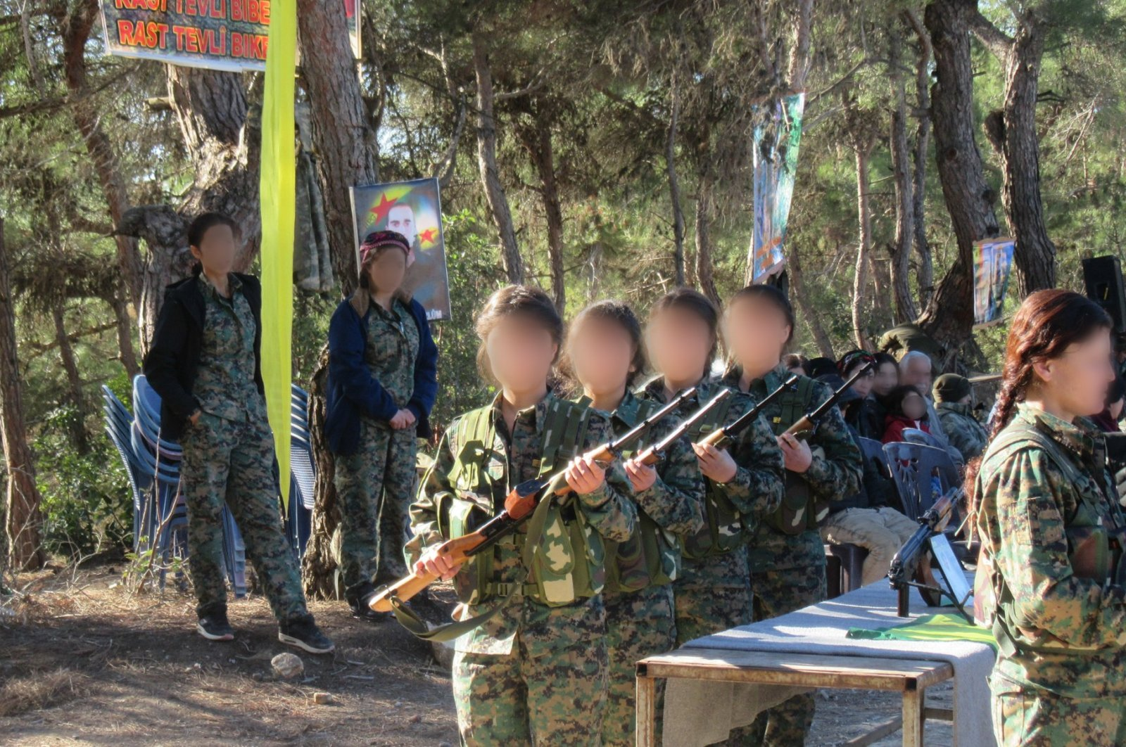 YPG/PKK's child soldiers receive training at an unknown location, Aug. 3, 2018. (AA Photo)
