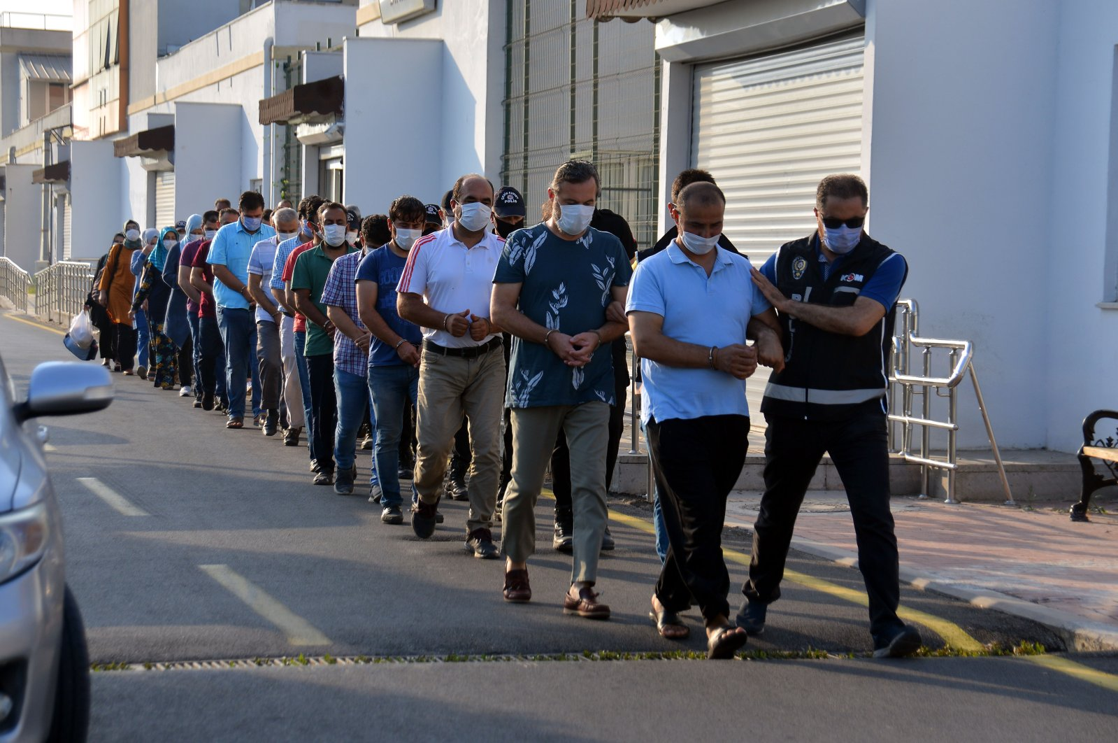 Police escort suspects captured in an operation against FETÖ, in Adana, southern Turkey, July 15, 2020. (DHA Photo)