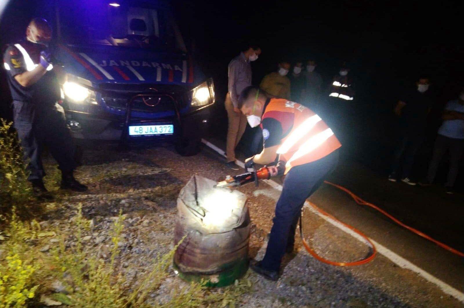 Gendarmerie officers open the barrel containing the body, in Muğla, southwestern Turkey, July 21, 2020. (DHA Photo)