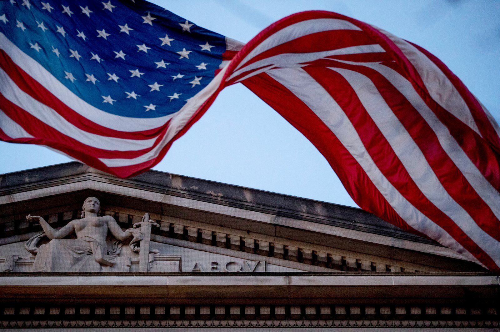 An American flag flies outside the Department of Justice in Washington, March 22, 2019 (AP Photo)