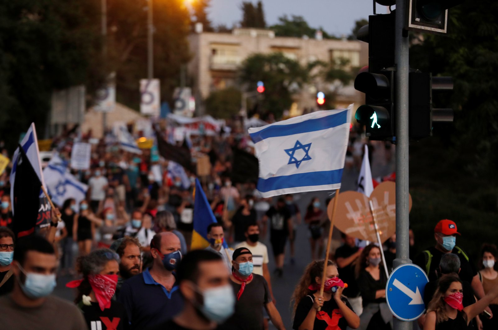 Israelis march as they protest against Israeli Prime Minister Benjamin Netanyahu and his government's response to the financial fallout of the coronavirus disease crisis in Jerusalem, July 21, 2020. (REUTERS)