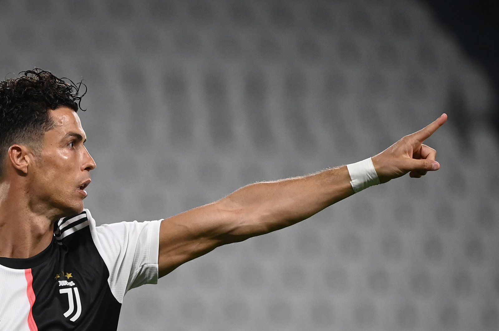 Juventus' Cristiano Ronaldo celebrates after scoring a goal during a Serie A match against Lazio, in Turin, Italy, July 20, 2020. (AFP Photo)