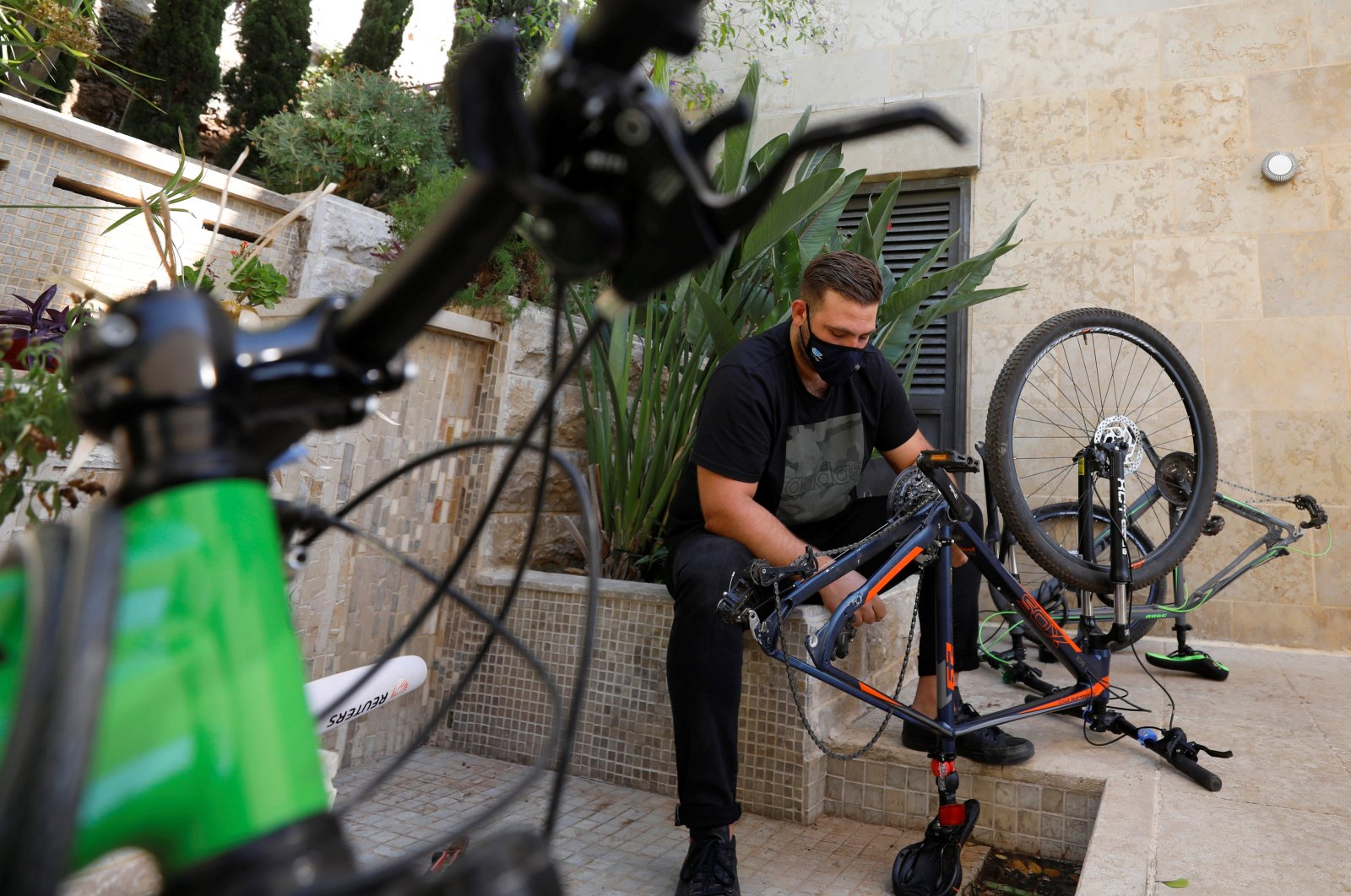Palestinian cyclist Samer Kurdi inspects his damaged bicycle in Ramallah in the Israeli-occupied West Bank, July 21, 2020. (Reuters Photo)