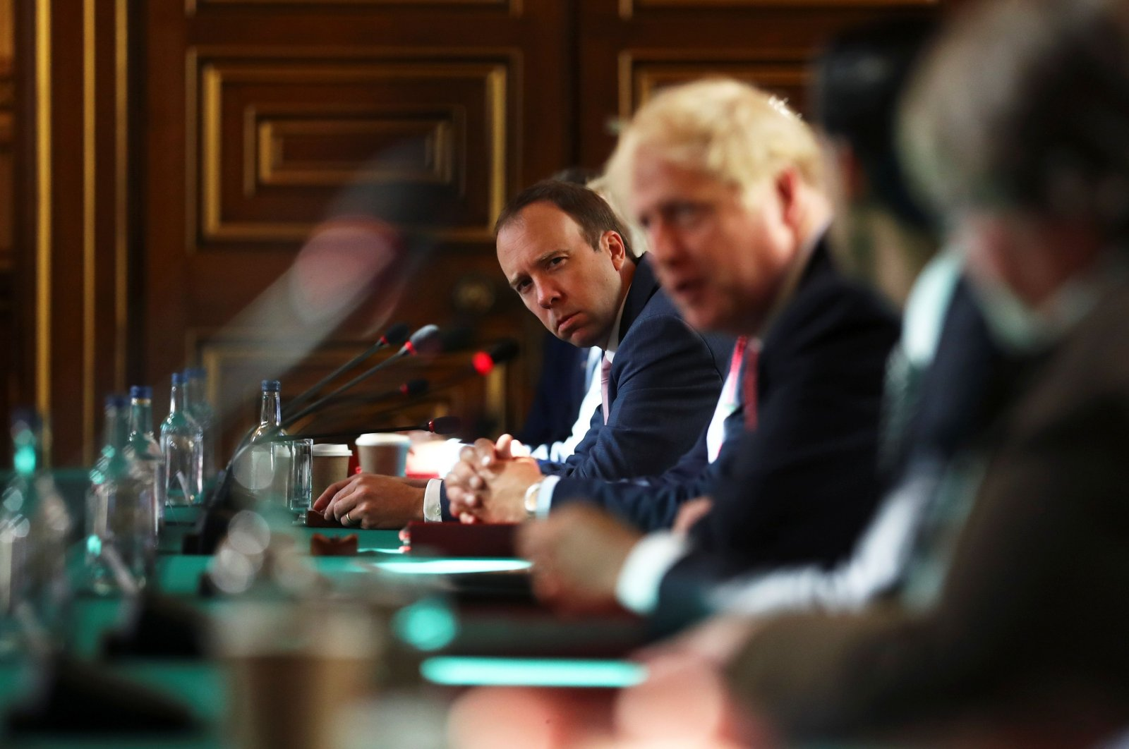 Britain's Health Secretary Matt Hancock (L) and Prime Minister Boris Johnson participate in the first face-to-face meeting of the Cabinet since mid-March because of the coronavirus pandemic, London, July 21, 2020. (AFP Photo)