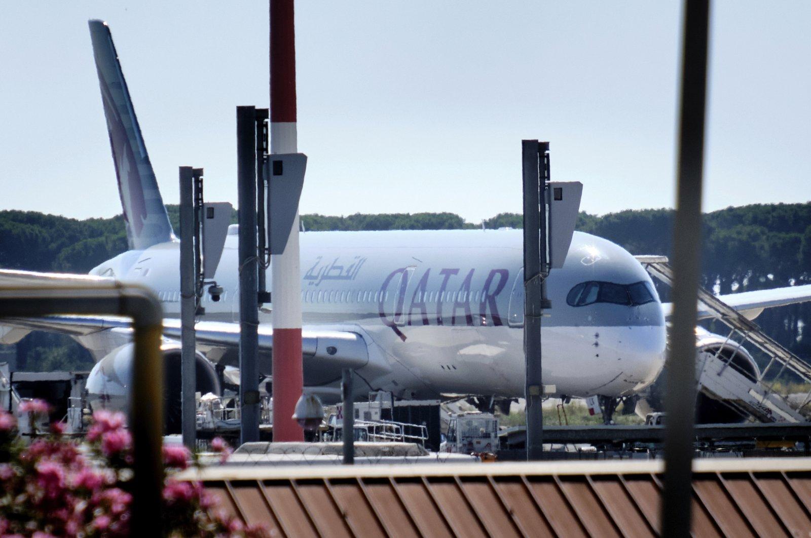 A Qatar Airways aircraft is parked at Rome's Leonardo Da Vinci international airport, July 8, 2020. (LaPresse via AP)