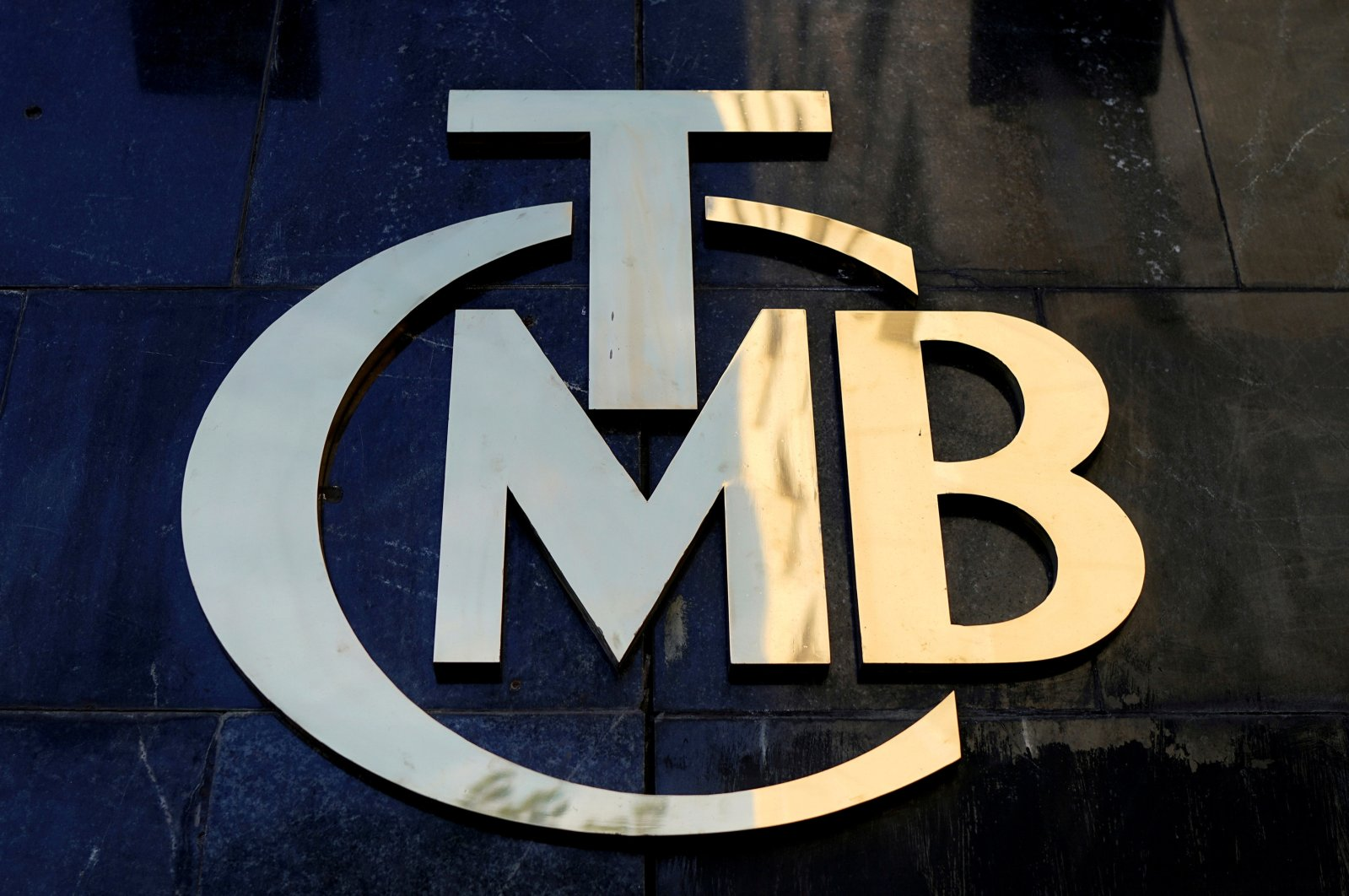 The logo of the Central Bank of the Republic of Turkey at the entrance of the bank's headquarters in Ankara, Turkey. (Reuters Photo)