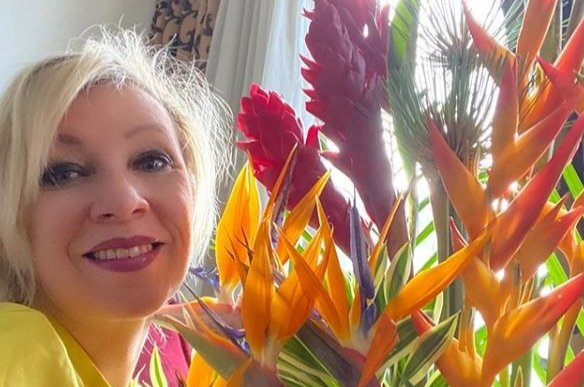 Russian Foreign Ministry spokeswoman Maria Zakharova poses with flowers in an Instagram photo. (Retrieved from Instagram)