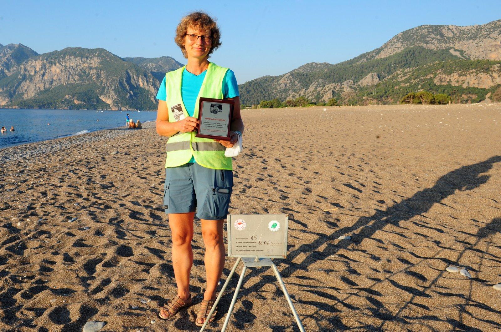 Anastasia Kolyada poses next to a Caretta caretta nest on Çıralı Beach, Antalya, July 22, 2020. (DHA Photo)