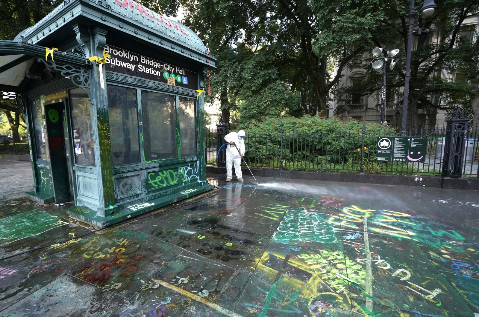 """Sanitation workers clean up graffiti after the """"Occupy City Hall"""" protesters were cleared out overnight by police, New York City, New York, U.S., July 22, 2020. (AFP Photo)"""