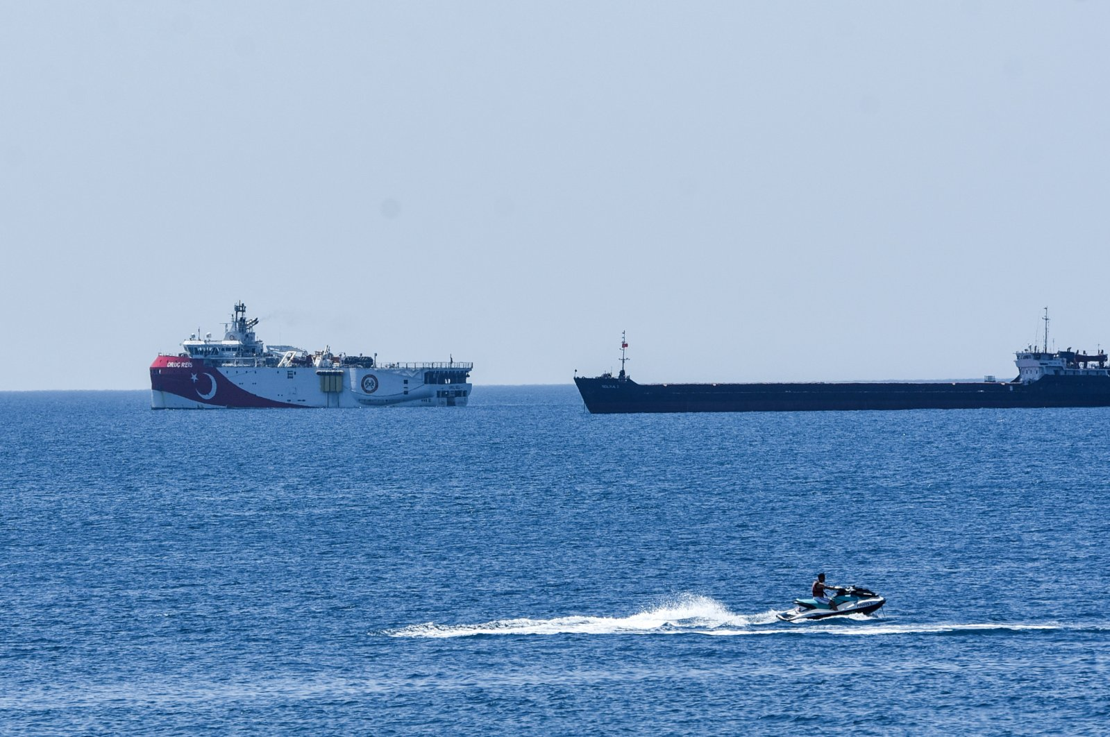 Turkey's seismic exploration vessel Oruç Reis is escorted by a Turkish Navy frigate off the shore of Antalya, southwest Turkey, July 22, 2020. (DHA Photo)