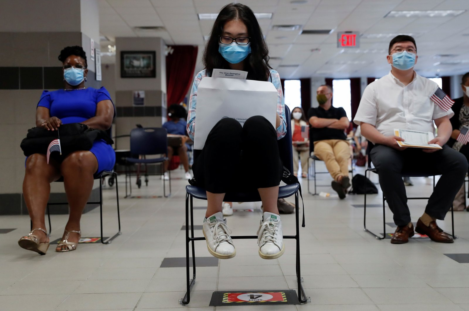 Citizen candidates sit socially distanced and wearing protective face masks, as the outbreak of the coronavirus continues, during a U.S. Citizenship and Immigration Services (USCIS) naturalization ceremony in New York City, New York, U.S., July 22, 2020. (Reuters Photo)