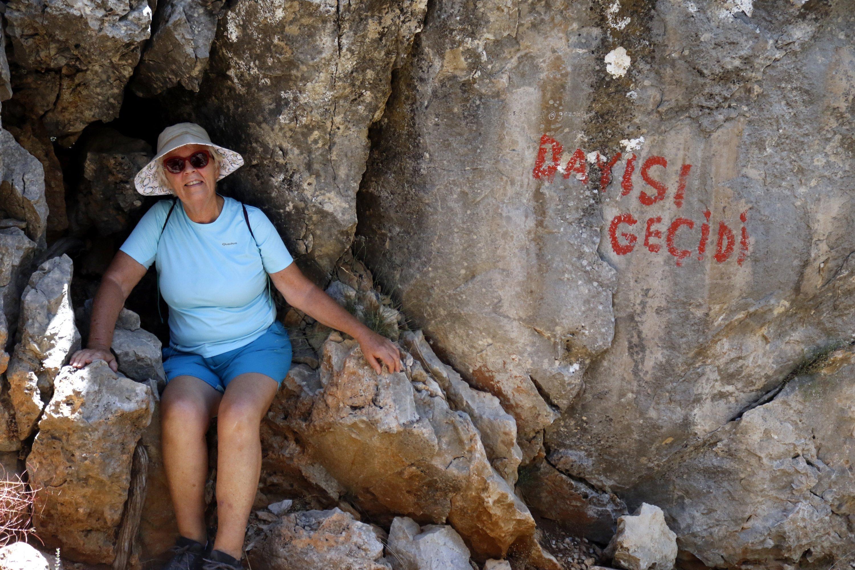Historian Kate Clow poses on some rocks in Antalya on Turkey's Mediterranean coast, July 23, 2020. (DHA Photo)