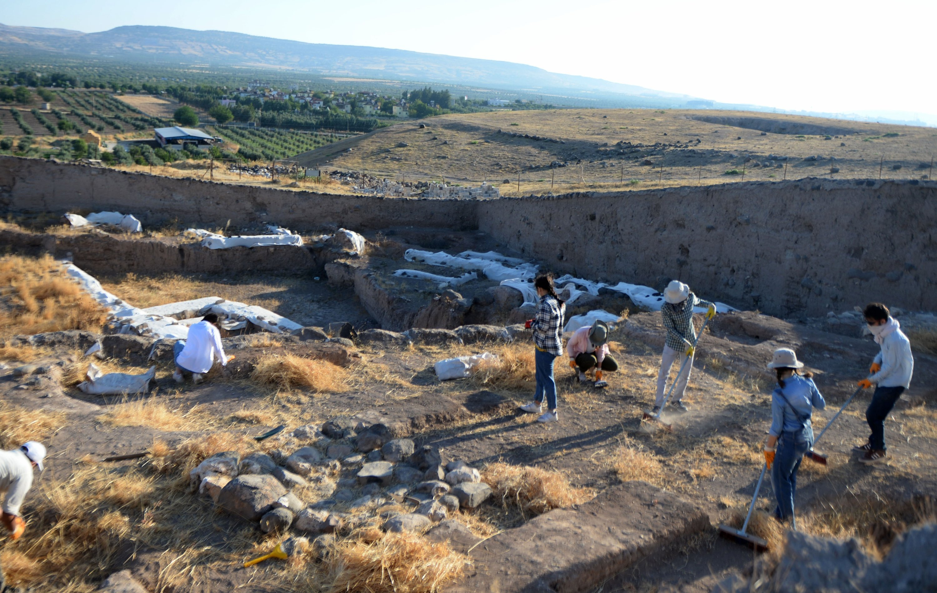 Members of the excavation team are seen while working at the site, Kilis, Turkey, July 21, 2020. (AA PHOTO)