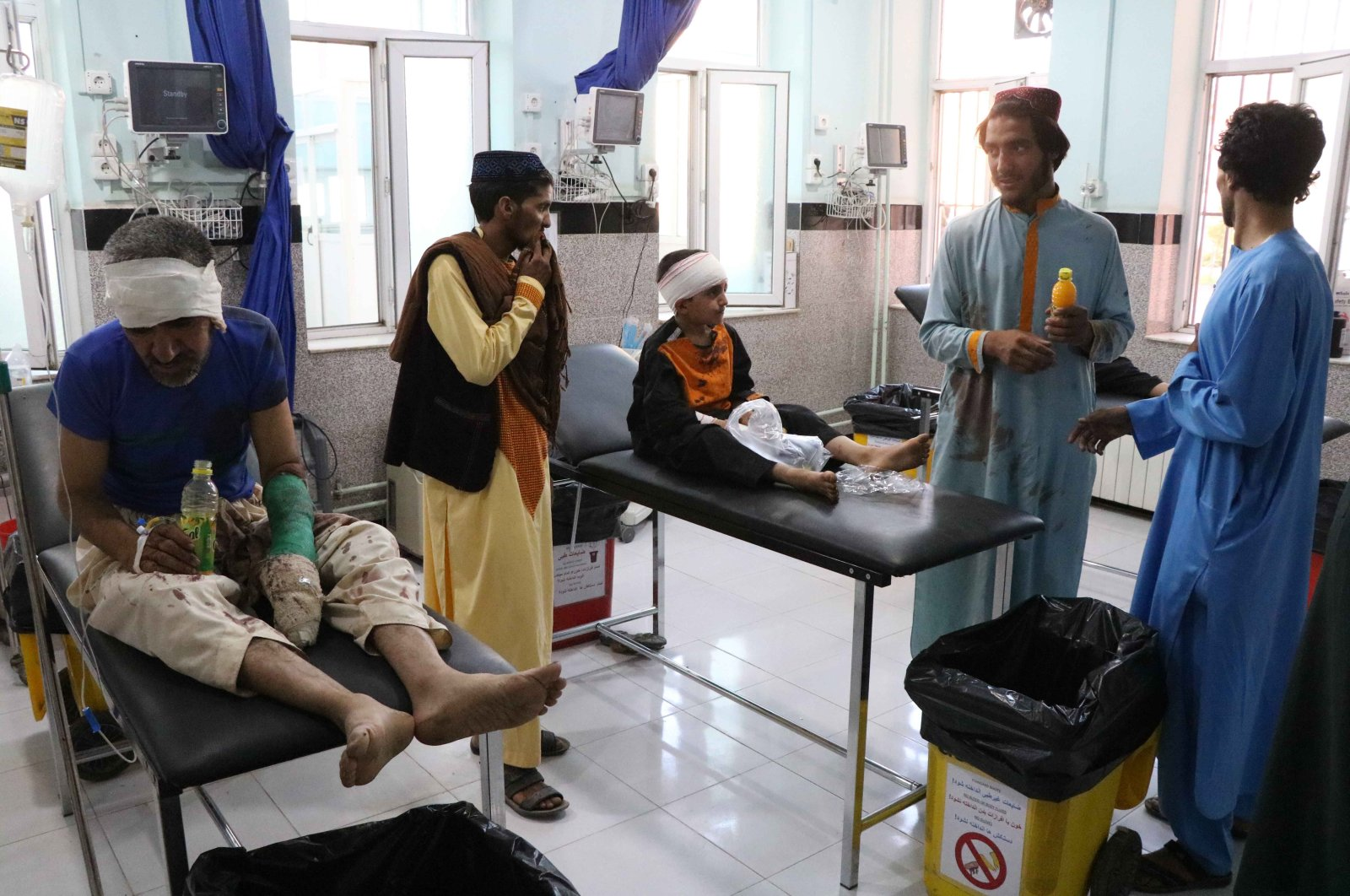 People who were injured in an alleged airstrike by Afghan security forces on suspected Taliban hideouts in Gozara district, receive medical treatment after they were brought to a hospital in Herat, Afghanistan, July 22, 2020. (EPA Photo)