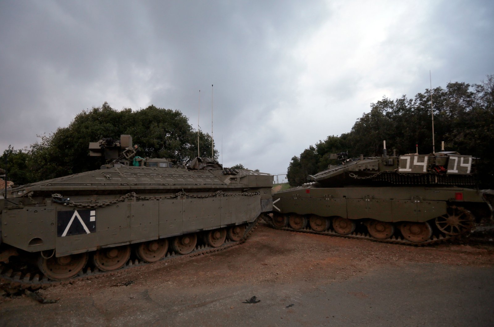 Israeli Merkava tanks park near the border with Lebanon, near the Israeli town of Zarit, Dec. 5, 2018. (AFP Photo)