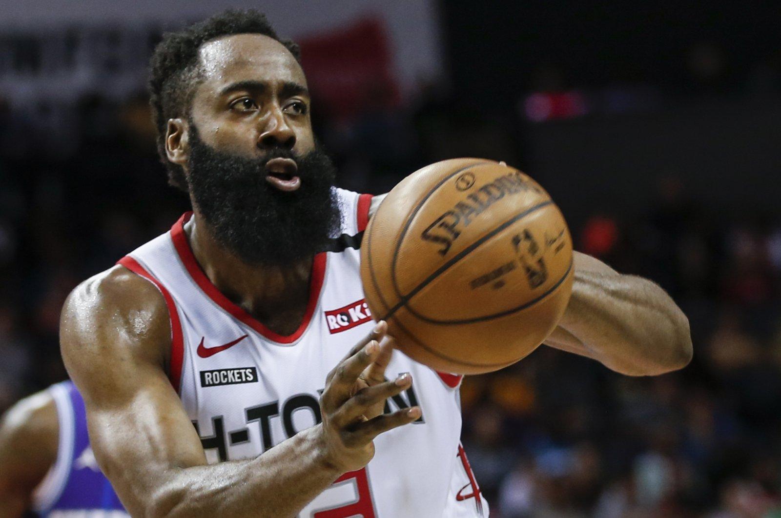 Houston Rockets' James Harden passes against the Charlotte Hornets, in Charlotte, North Carolina, U.S., March 7, 2020. (AP Photo)