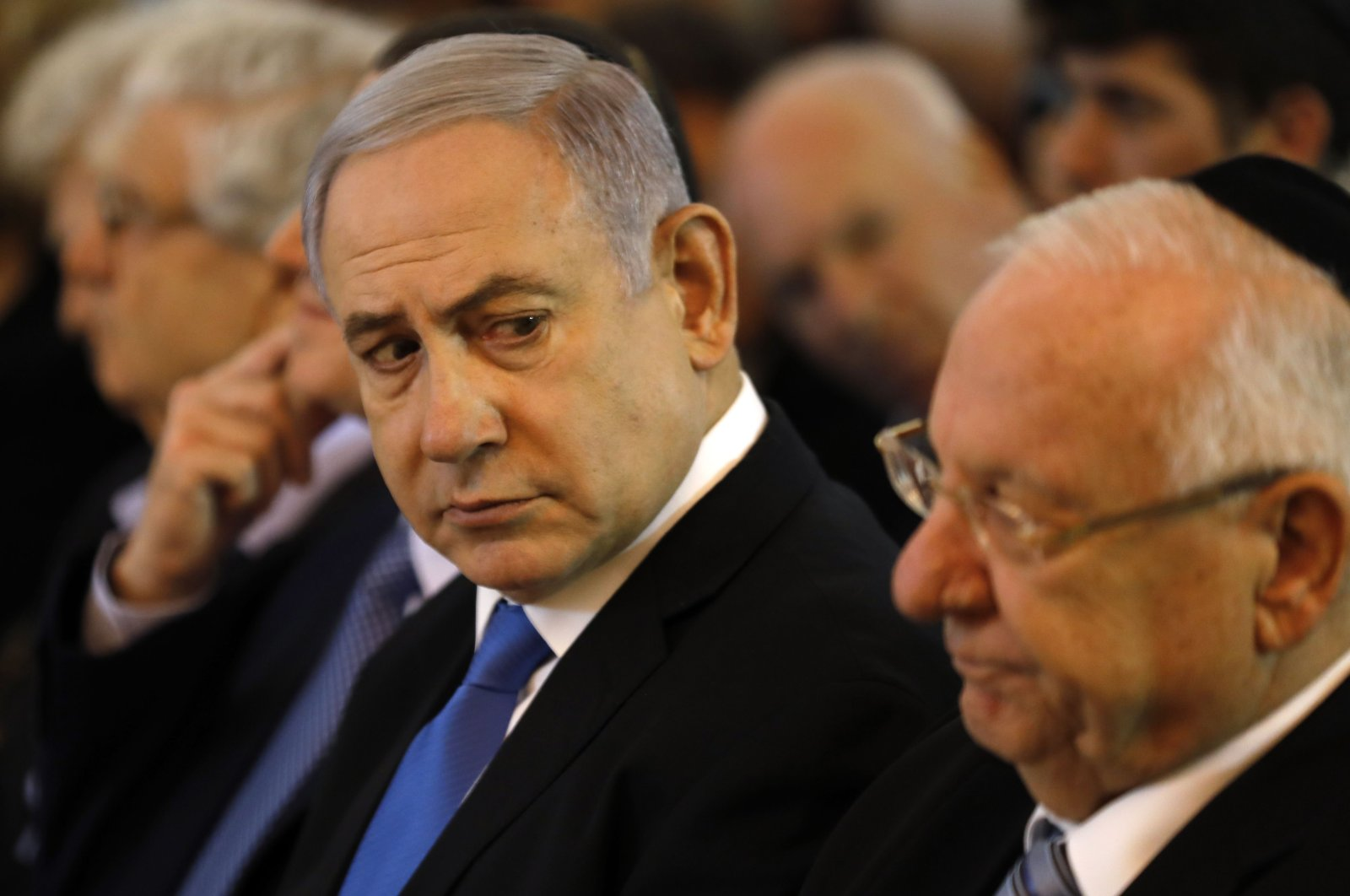 Israeli Prime Minister Benjamin Netanyahu (L) and President Reuven Rivlin attend a ceremony in tribute to the recently deceased former Supreme Court president Meir Shamgar ahead of his funeral, in Jerusalem, Oct. 22, 2019. (AFP Photo)