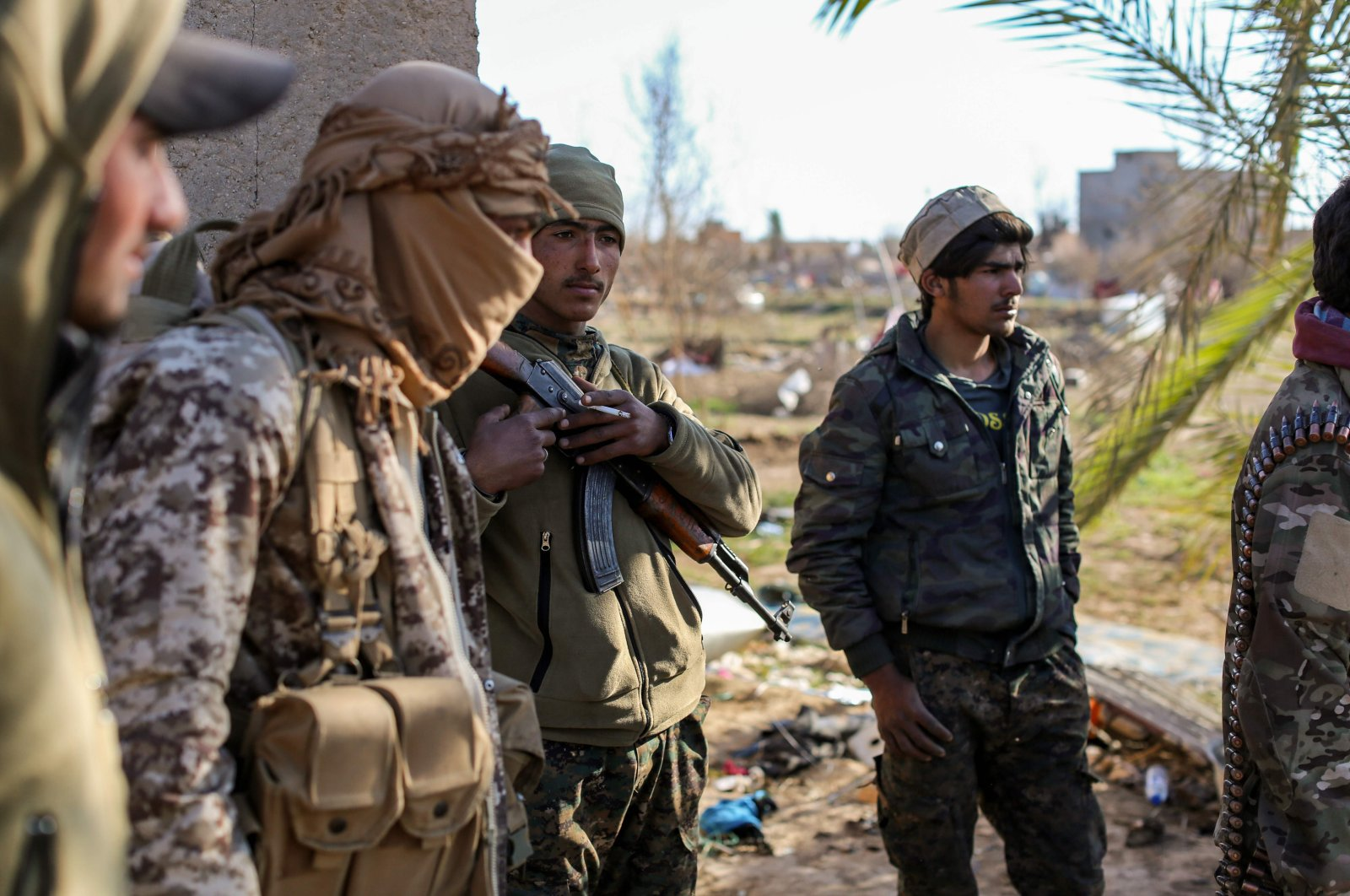 YPG/PKK terrorists check a makeshift camp for Daesh terror group members and their families in the town of Baghouz, in the eastern Syrian province of Deir el-Zour, March 9, 2019. (AFP Photo)
