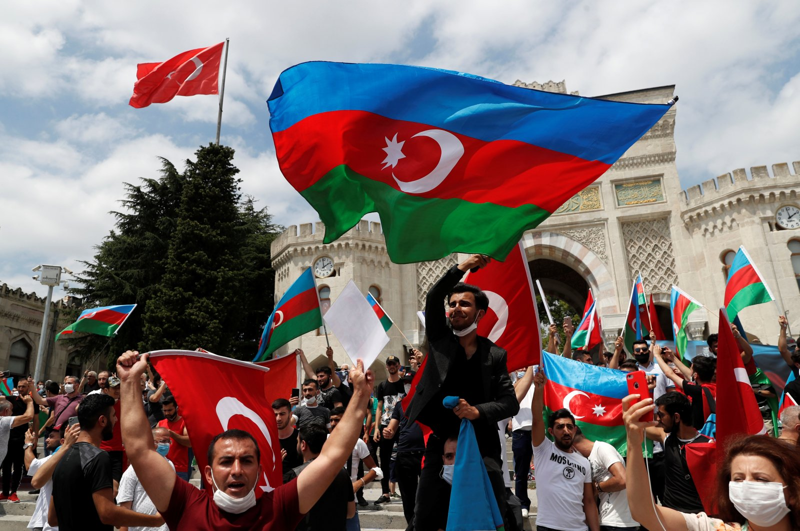 Azerbaijani men living in Turkey wave flags of Turkey and Azerbaijan during a protest following clashes between Azerbaijan and Armenia, in Istanbul, Turkey, July 19, 2020. (Reuters Photo)