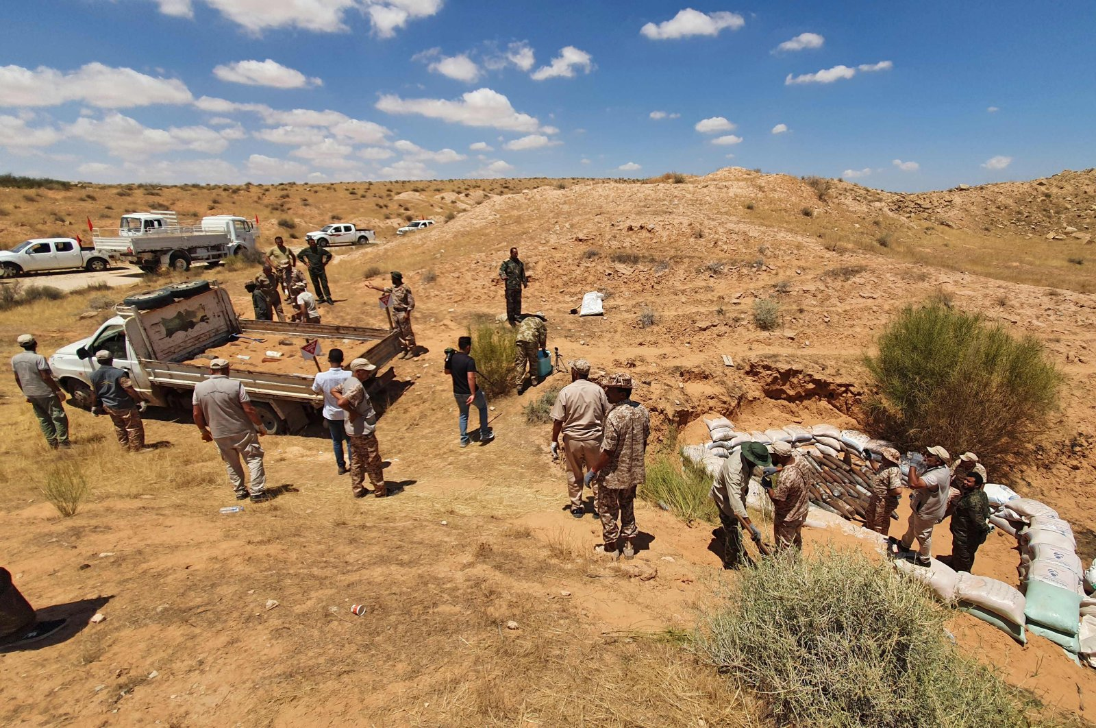 Military engineers of the U.N.-recognised Libyan Government of National Accord (GNA) demine an area south of the capital Tripoli, July 22, 2020. (AFP Photo)