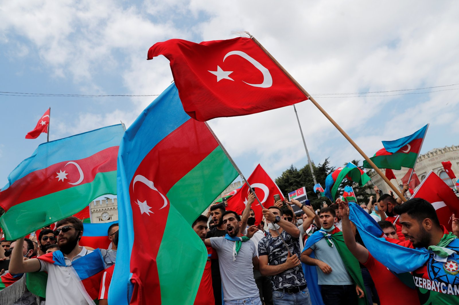 Azerbaijani men living in Turkey wave flags of Turkey and Azerbaijan during a protest following clashes between Azerbaijan and Armenia, in Istanbul, July 19, 2020. (Reuters Photo)
