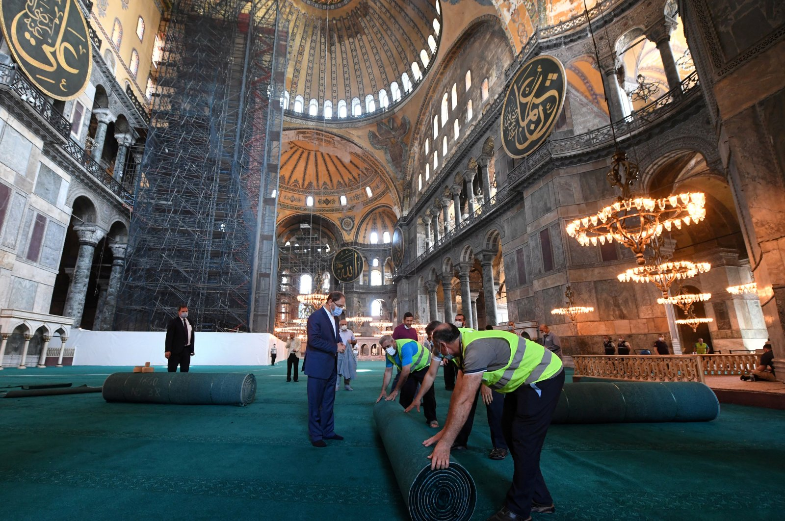 Head of Turkey's Religious Affairs Directorate (Diyanet) Ali Erbaş visits Hagia Sophia Mosque as workers lay carpets in Istanbul, July 22, 2020. (Reuters Photo)
