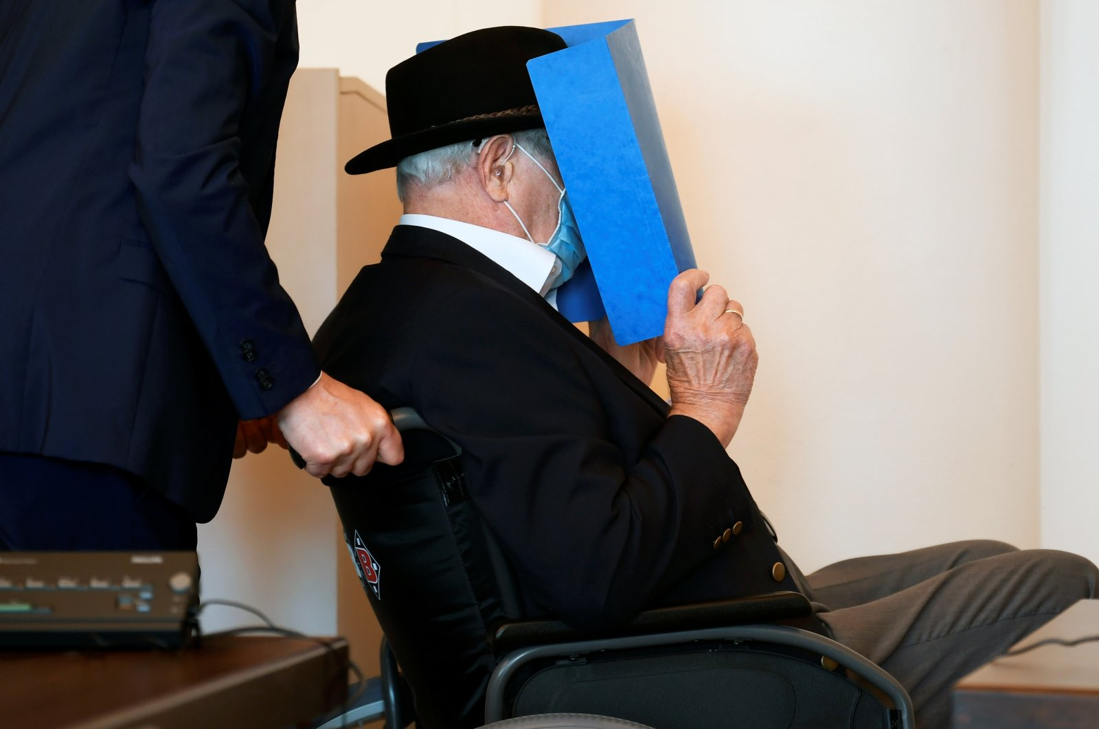 The 93-year-old German Bruno D. accused of being an SS guard involved in killings of thousands of prisoners, many of them Jewish, between  August 1944 and April 1945, in the Stutthof Nazi concentration camp near Gdansk, Poland, arrives for the verdict in his trial, in a courtroom in Hamburg, Germany, July 23, 2020. (Reuters Photo)