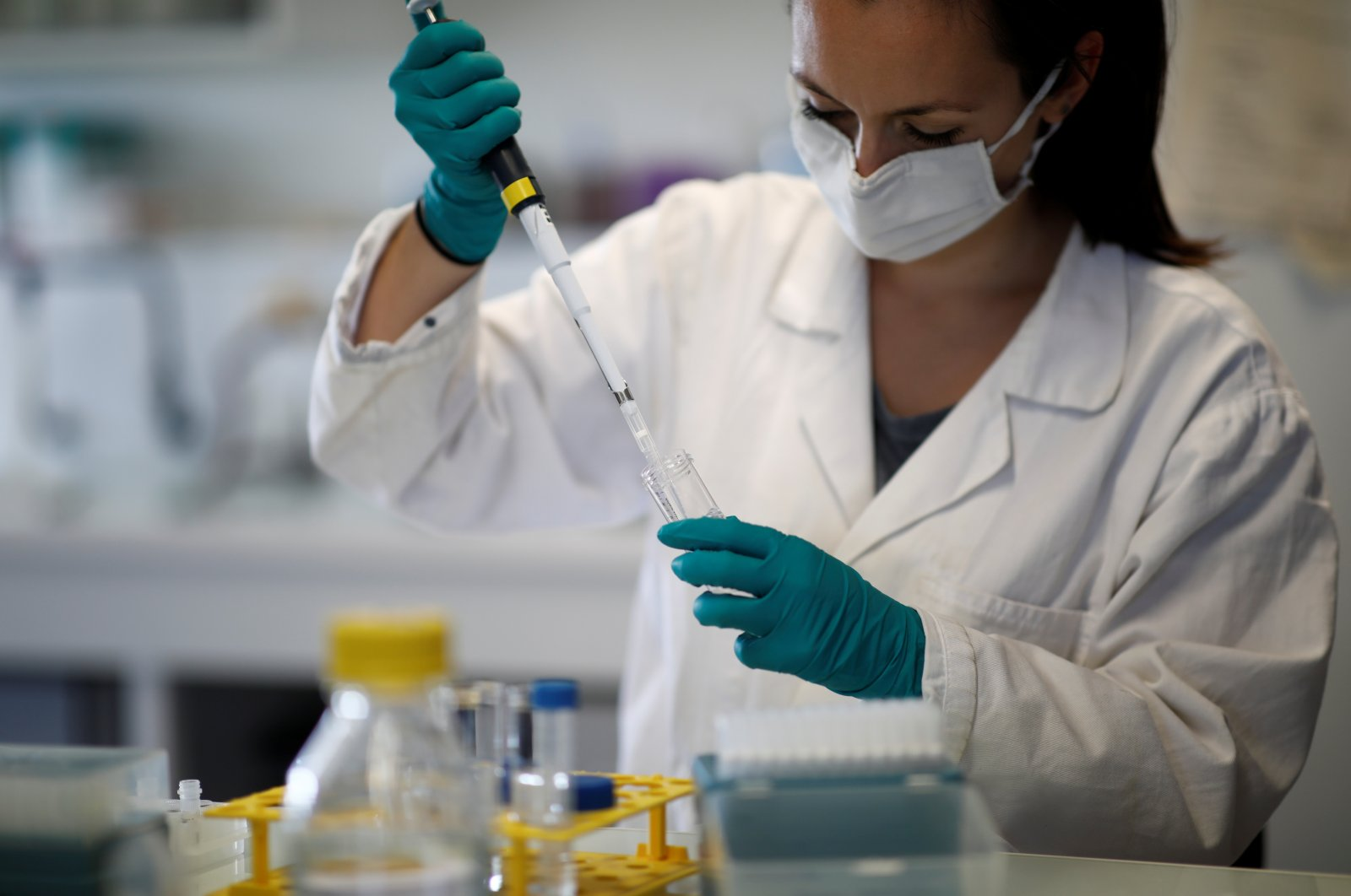 A water quality scientist conducts tests on a water sample at the Eau de Paris research and analysis laboratories in Ivry-sur-Seine, near Paris, France, July 22, 2020. (Reuters Photo)