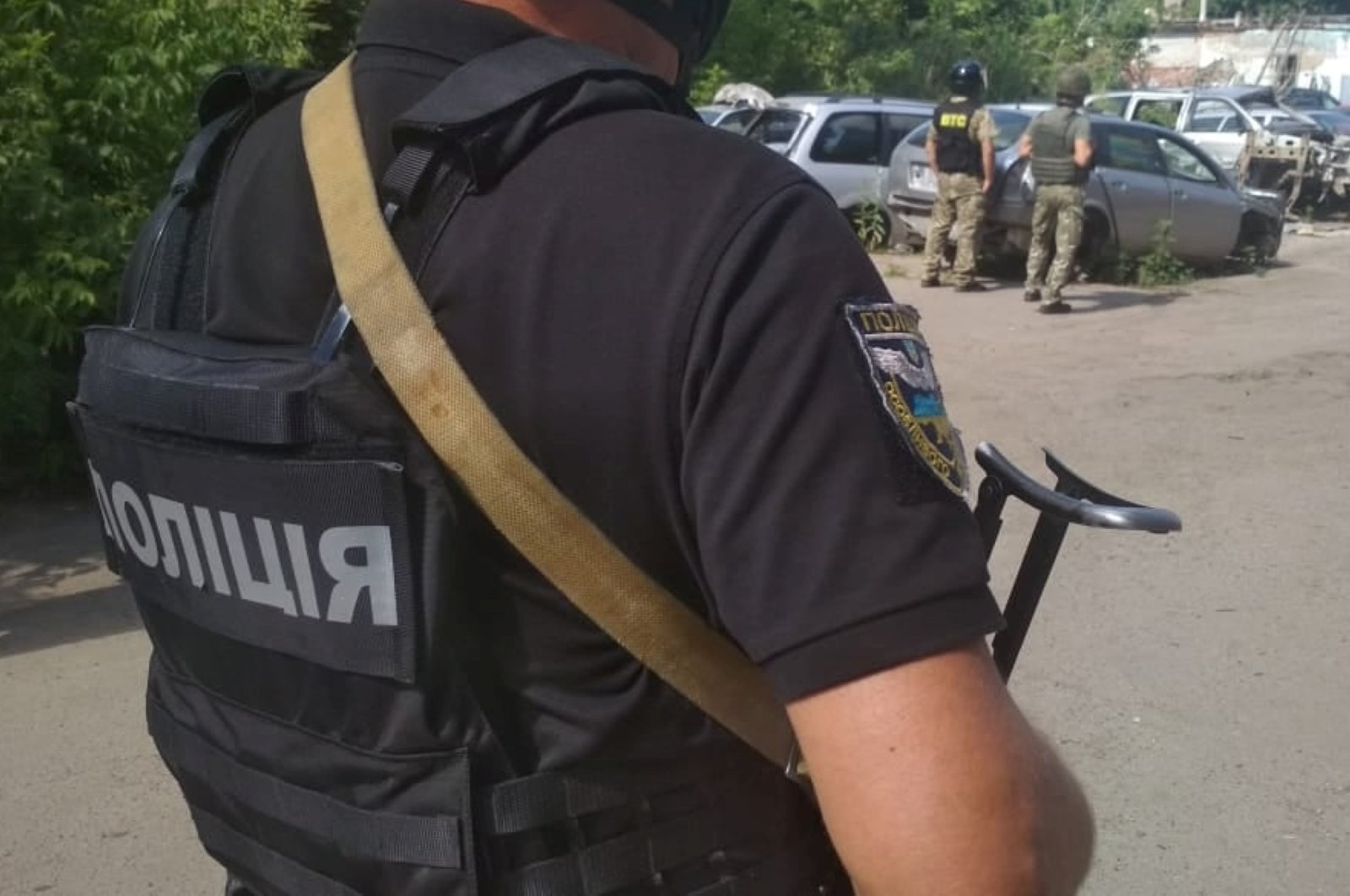 Ukrainian law enforcement officers are seen near a site where a man armed with a grenade holds a policeman hostage in Poltava, Ukraine, July 23, 2020. (Reuters Photo)