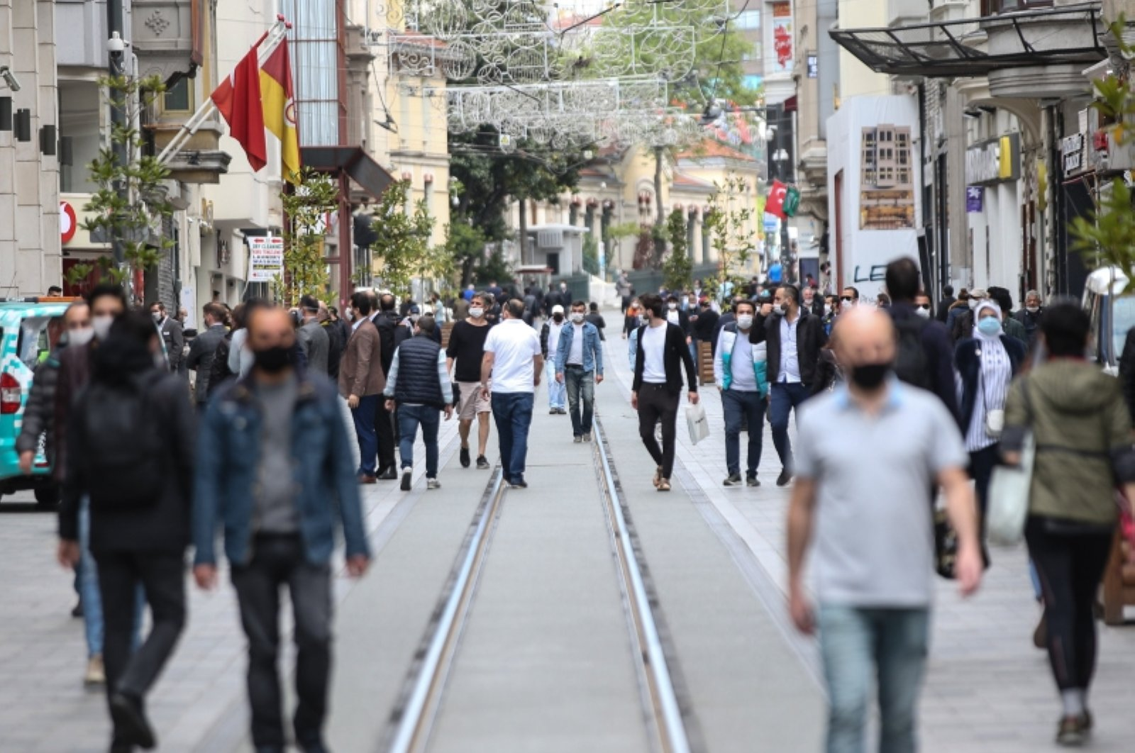 People wearing masks walk on Istanbul's famous Istiklal Avenue in Taksim on May 9, 2020. (AA File Photo