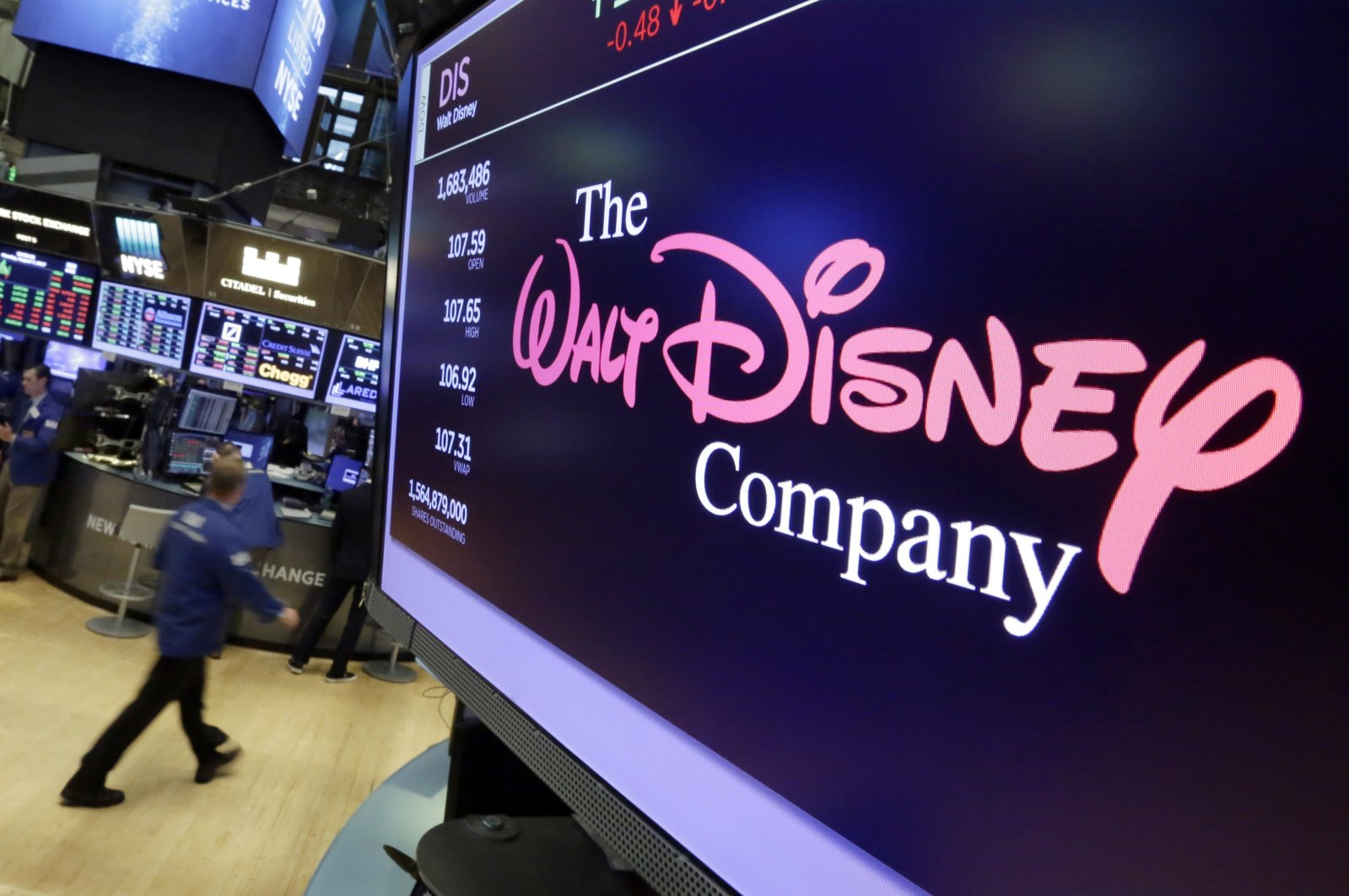 In this Aug. 8, 2017, file photo, The Walt Disney Co. logo appears on a screen above the floor of the New York Stock Exchange. (AP Photo)