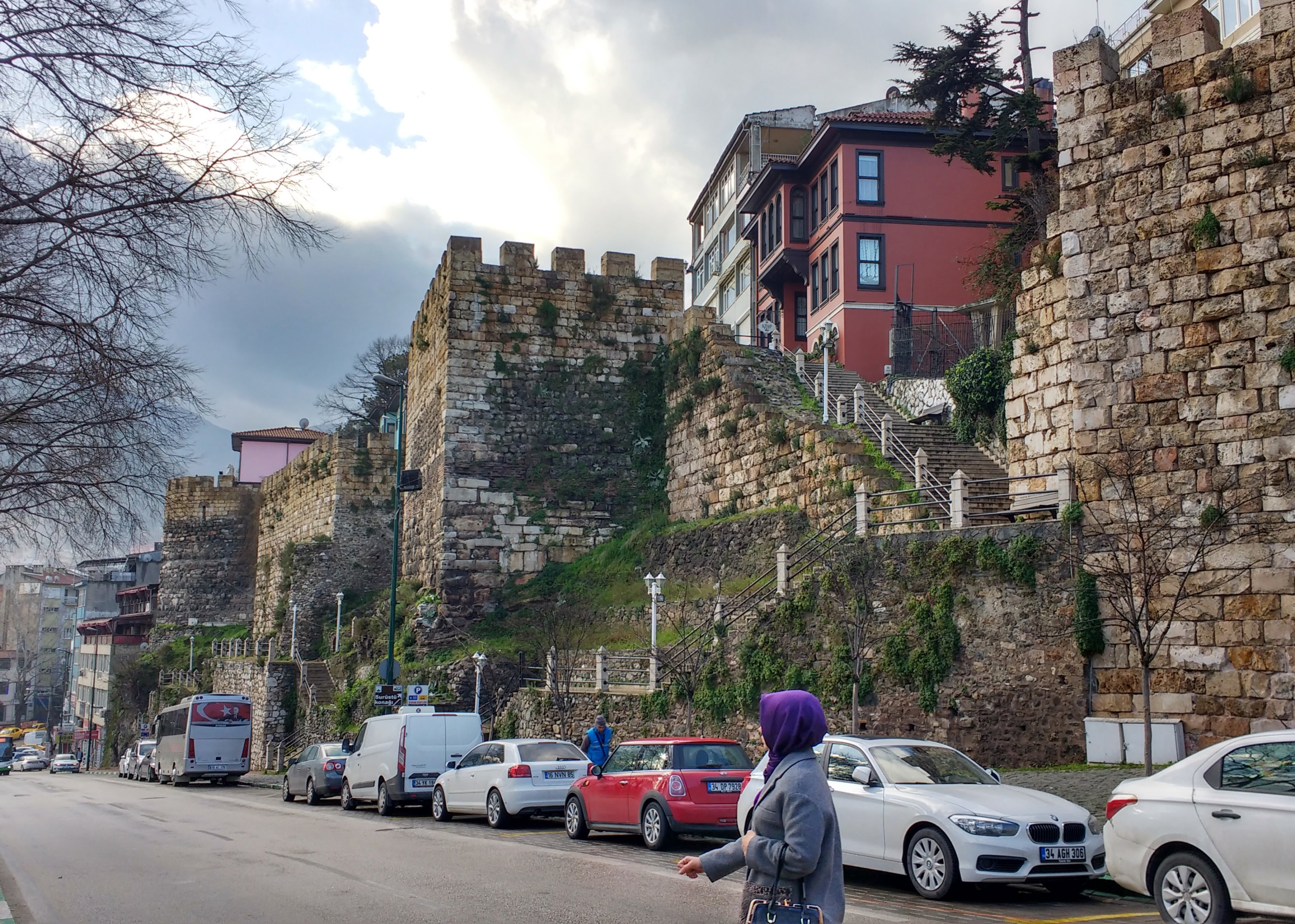 A woman walks next to the historic city walls of Bursa, northwestern Turkey, Feb. 11, 2018. (Gabriela Akpaça / Daily Sabah)