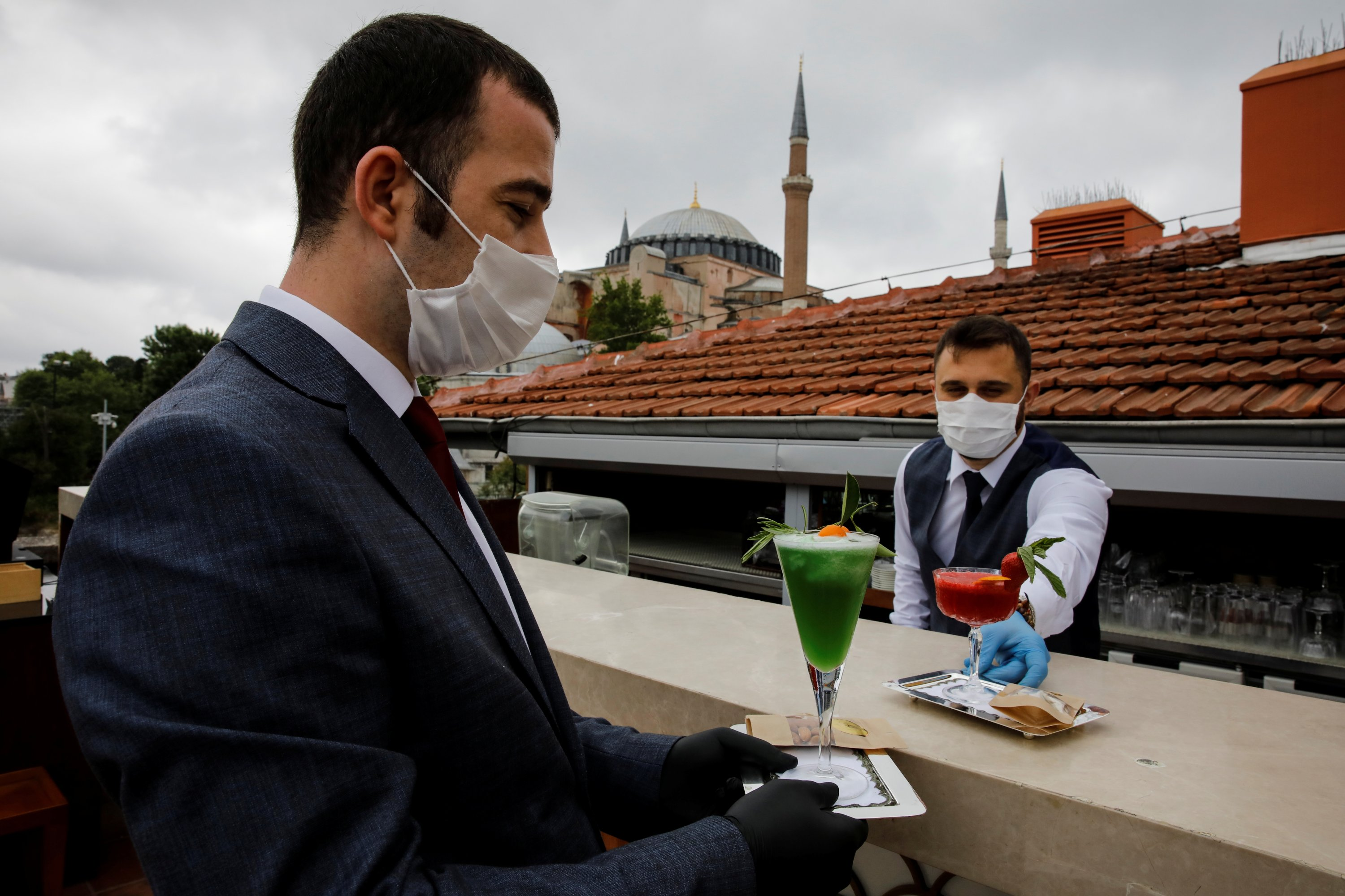 Four Seasons Sultanahmet Hotel staff members practice a service as part of COVID-19 measures in Istanbul, May 21, 2020. (Reuters Photo)