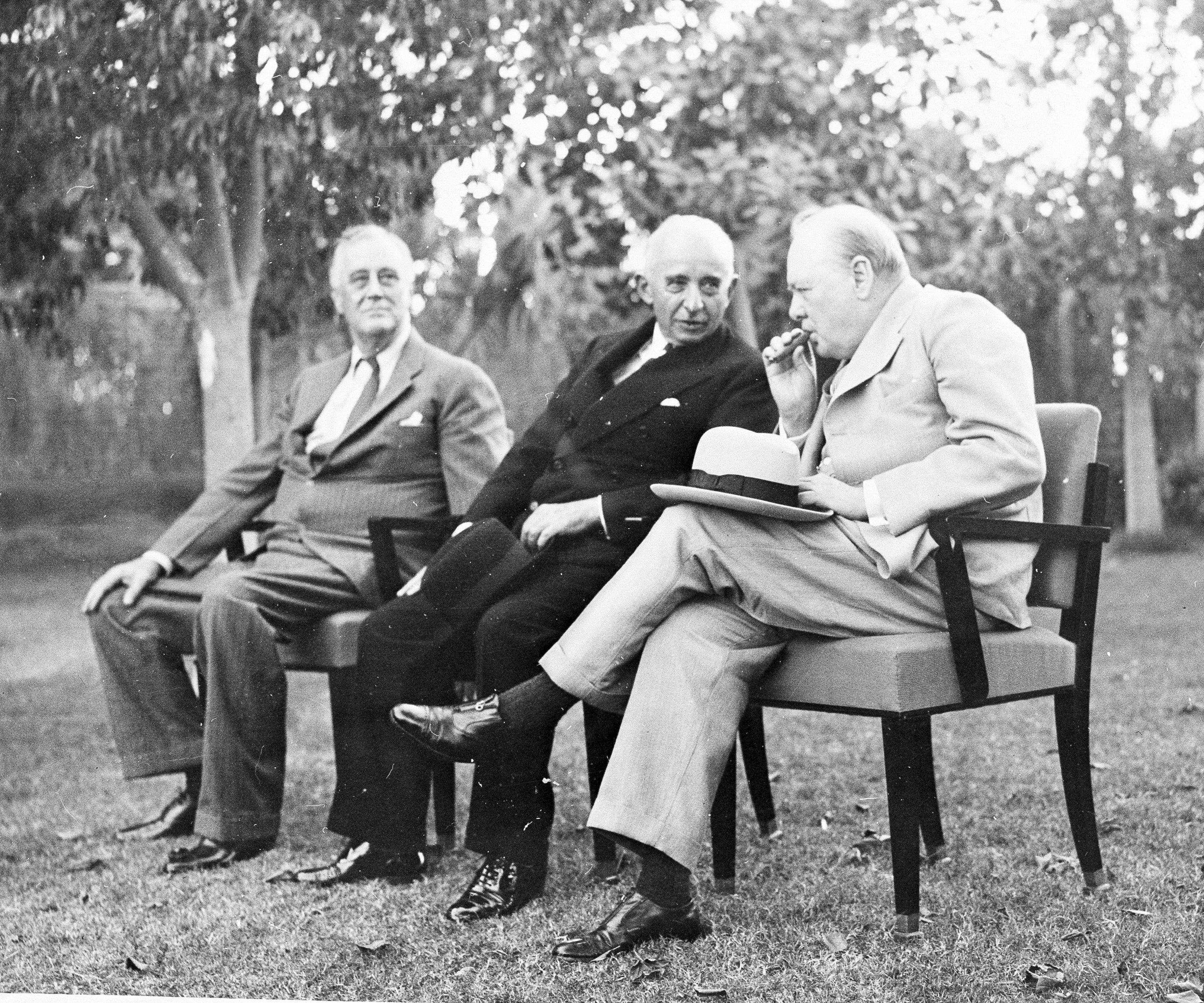 In this photo provided by the U.S. Army Air Force, Turkish President Ismet Inönü (C), poses with President Franklin D. Roosevel (L), and Prime Minister Winston Churchill during an interlude in their conference at Cairo, Egypt, Dec. 4, 1943. (AP Photo)