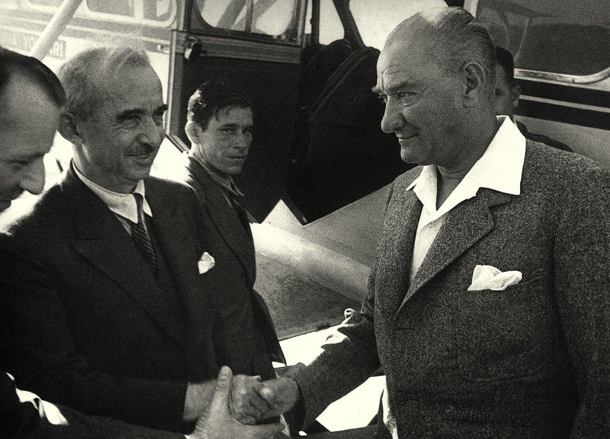 President Mustafa Kemal Atatürk and Prime Minister Ismet Inönü shake hands at the gate of a Turkish Airlines plane on June 16, 1936.