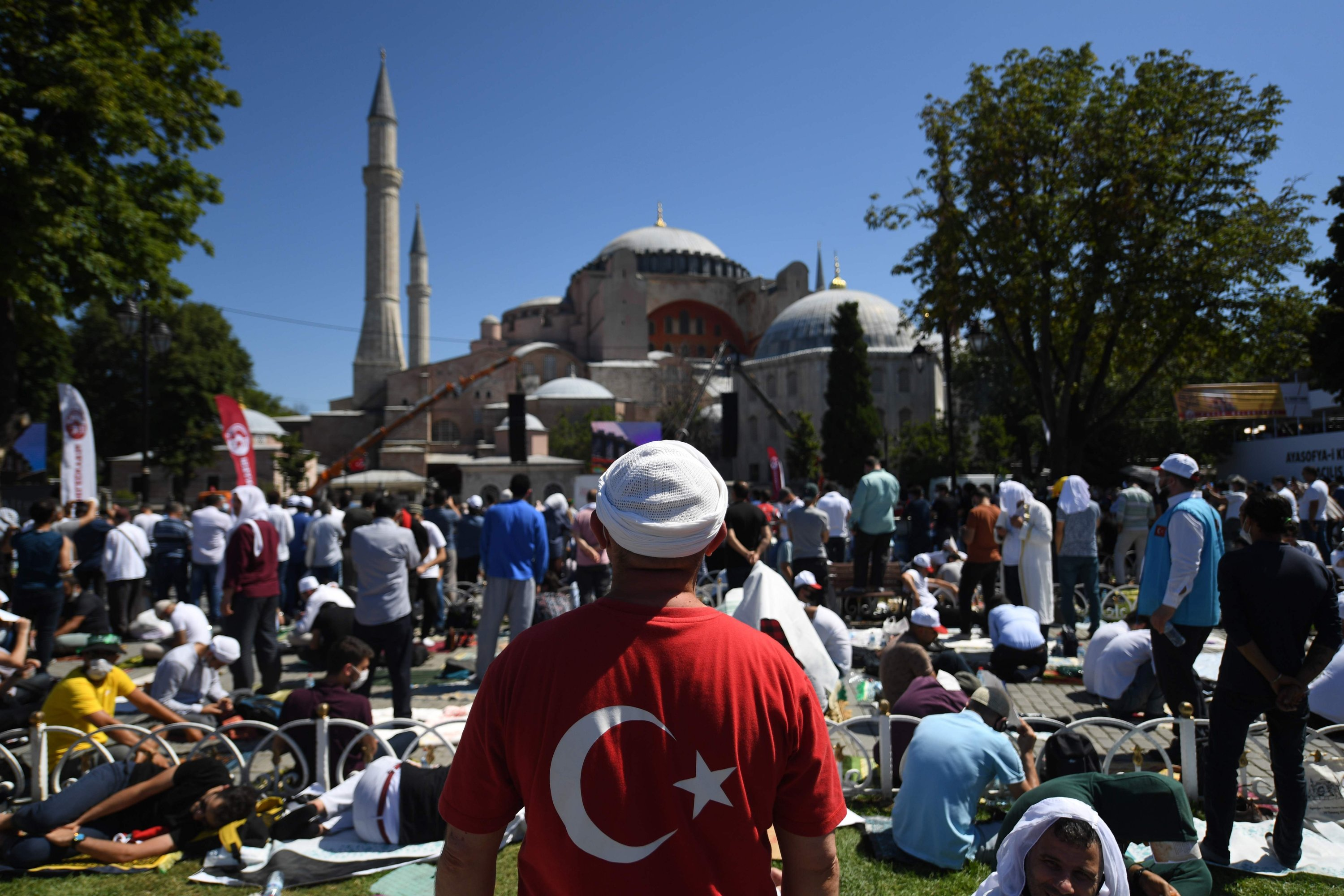 Men wait outside Hagia Sophia Grand Mosque in Istanbul to attend the Friday prayer, the first Muslim prayer held at the landmark since it was turned to a mosque, July 24, 2020. (AFP Photo)