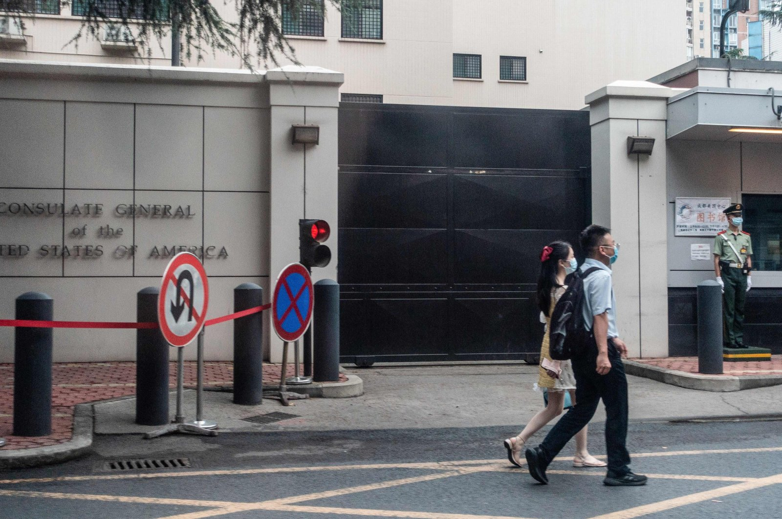 People walk past the entrance of the U.S. consulate in Chengdu in southwest China's Sichuan province, July 23, 2020. (AFP Photo)